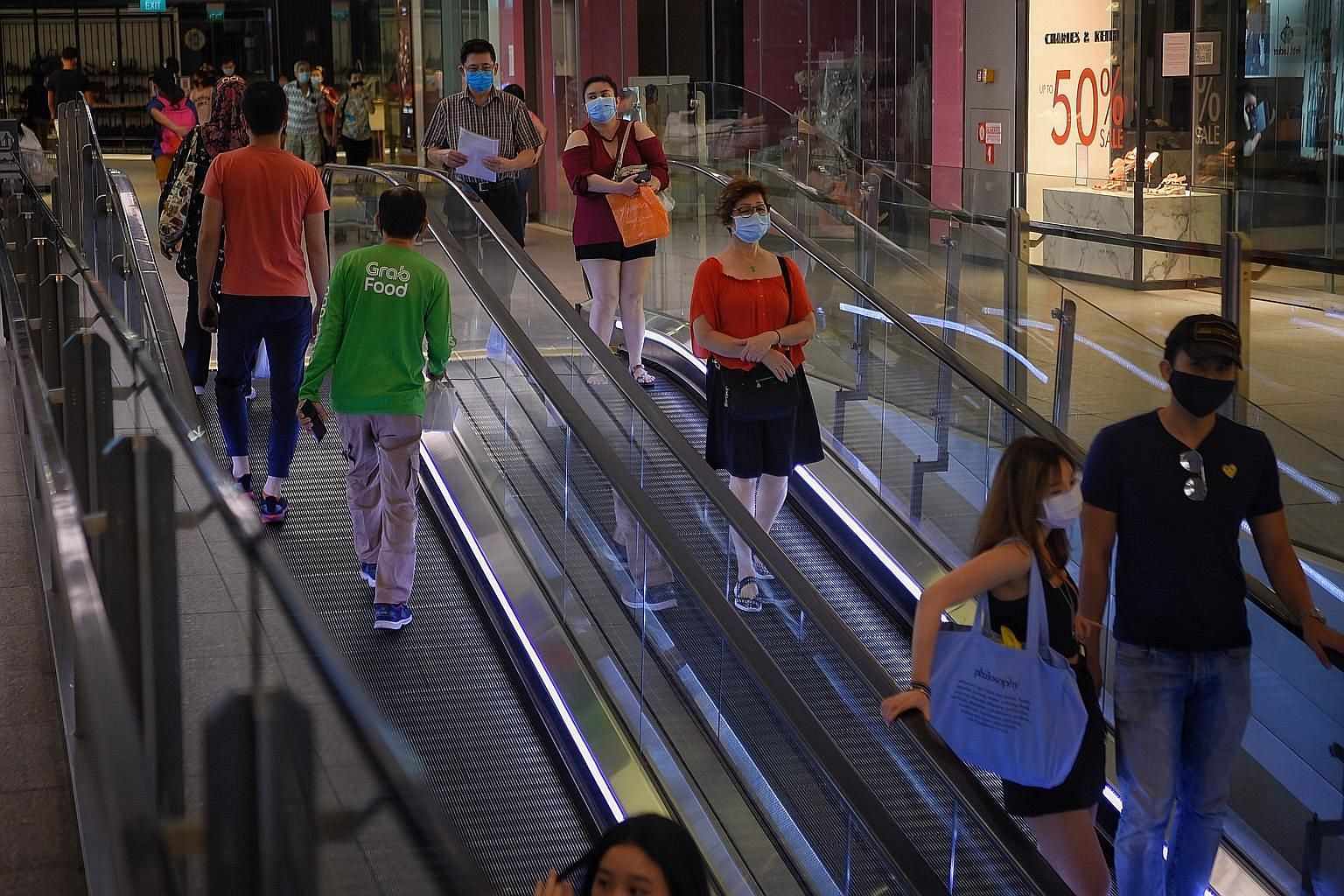 Above: People at Jem mall in Jurong yesterday. The Government is carefully monitoring the effects of increased activity in phase one of the reopening, and if the community infection rates remain low and stable, phase two could happen before the end o