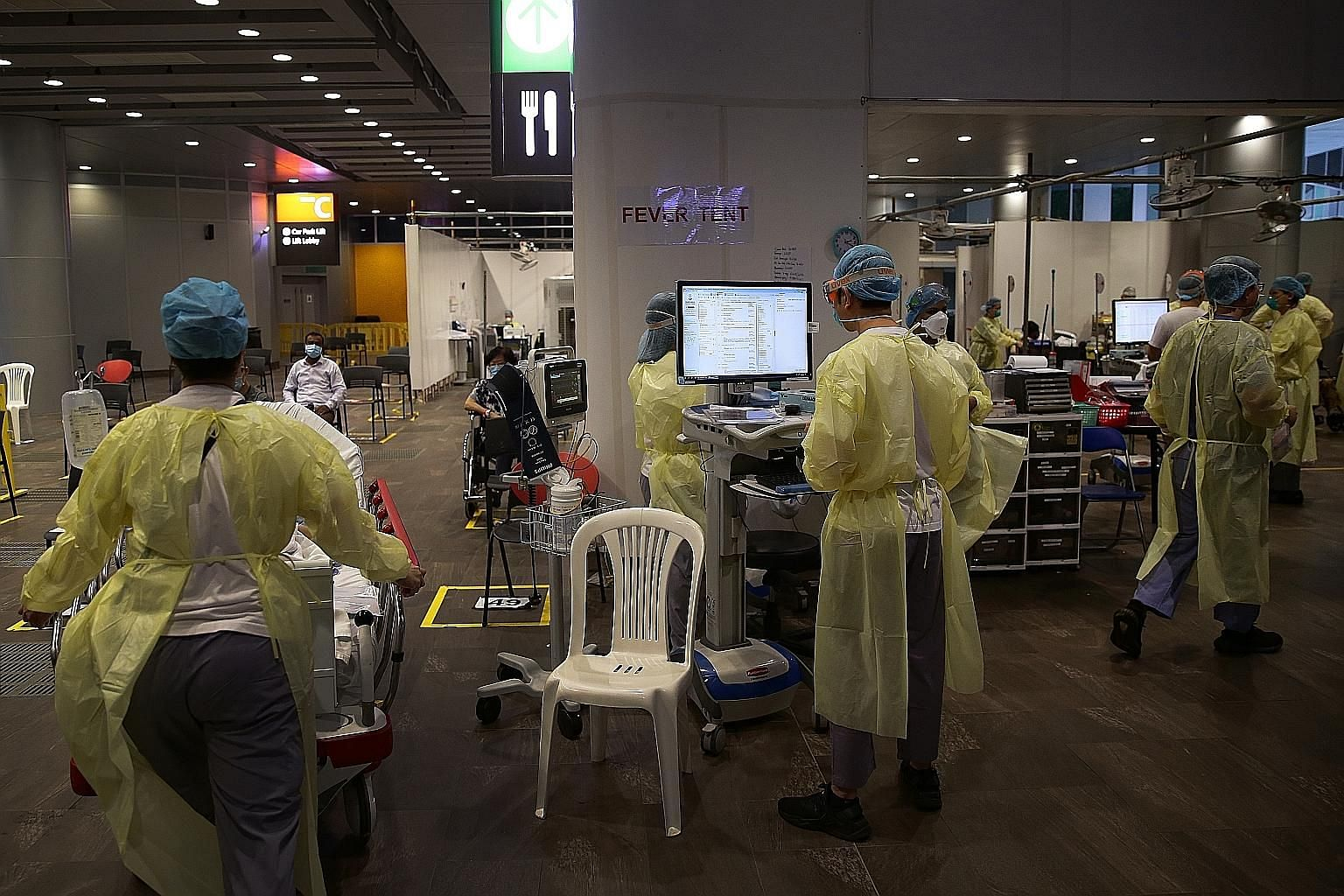Healthcare workers in the fever tent at Ng Teng Fong General Hospital, one of 11 hospitals that are part of the scheme. The initiative by Singapore Press Holdings is to show appreciation for healthcare professionals' work and dedication amid the Covi