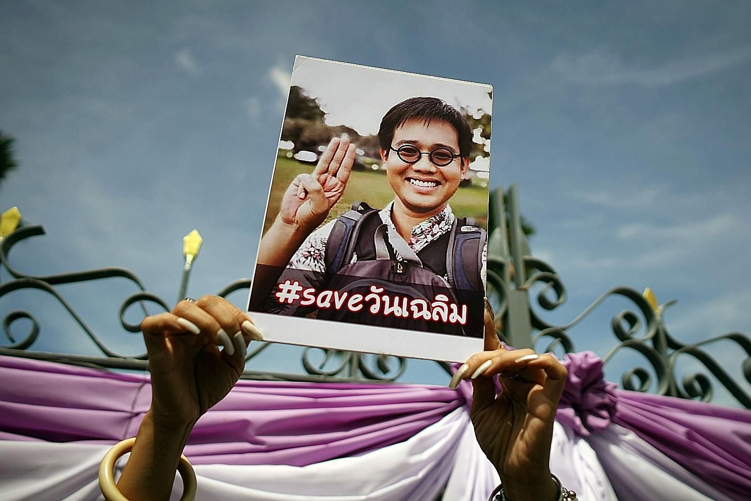 A poster of missing Thai activist Wanchalearm Satsaksit being held up during a protest outside Prime Minister Prayut Chan-o-cha's offices in Bangkok yesterday. Wanchalearm fled from Thailand following a 2014 military coup and is suspected to have bee