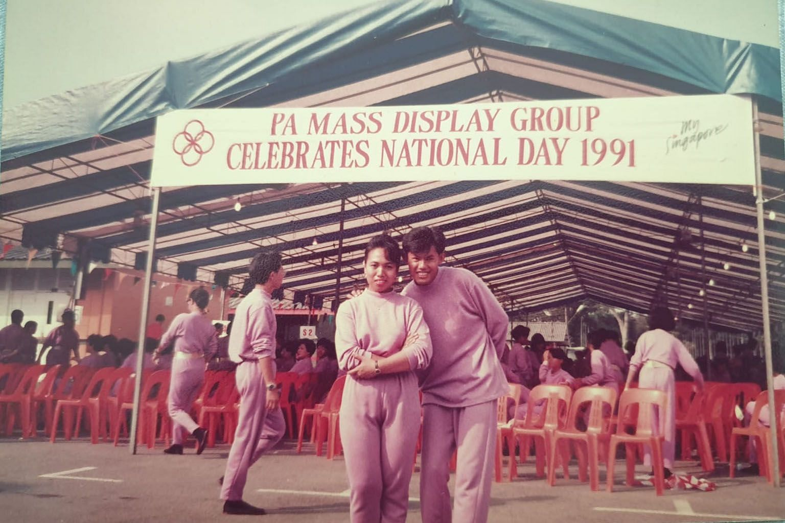 Mr Clarence Chan (right), with a fellow participant from the People's Association at the former PA headquarters opposite the old National Stadium in Kallang, during rehearsals for NDP 1991.