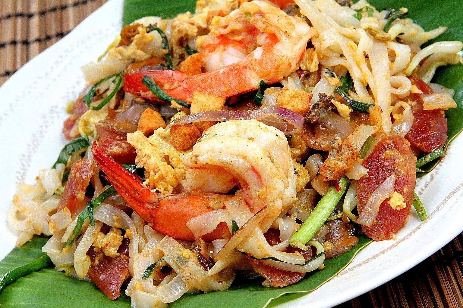 Recreate the yolkiness of Penang char kway teow by using extra-large eggs and adding an extra yolk.
