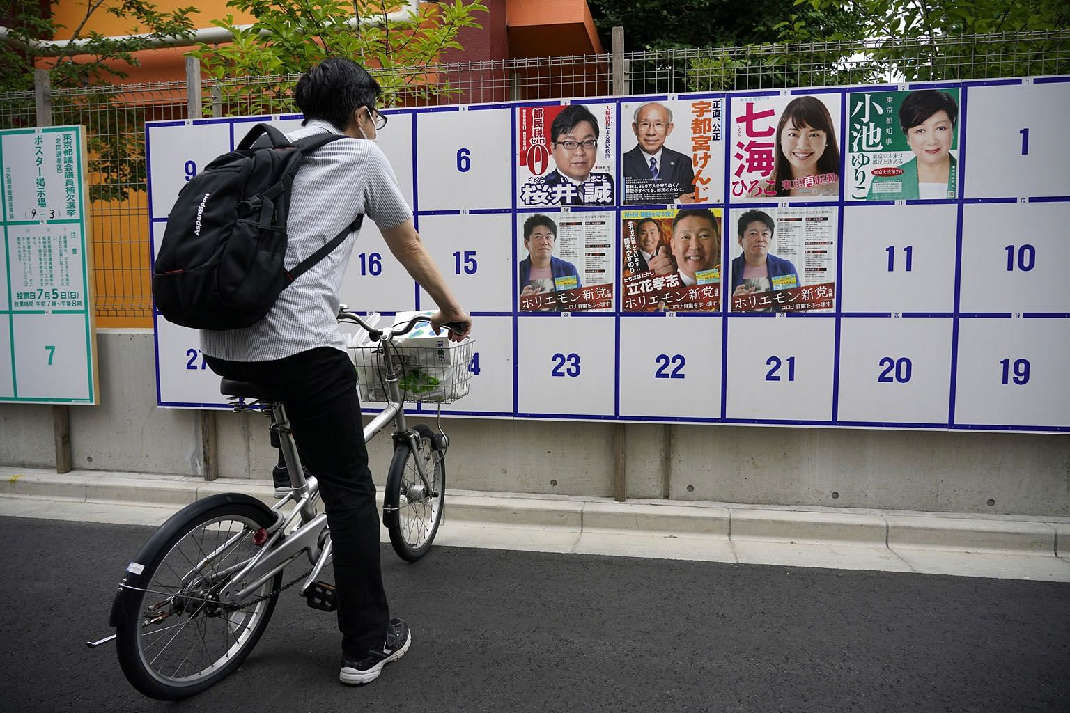 """Posters of some candidates for the governorship of Tokyo on a wall in the Japanese capital. Ms Yuriko Koike (featured in the top-right poster) is bidding to retain her office. Critics say she has managed to achieve only one of """"seven zeros"""" from her"""