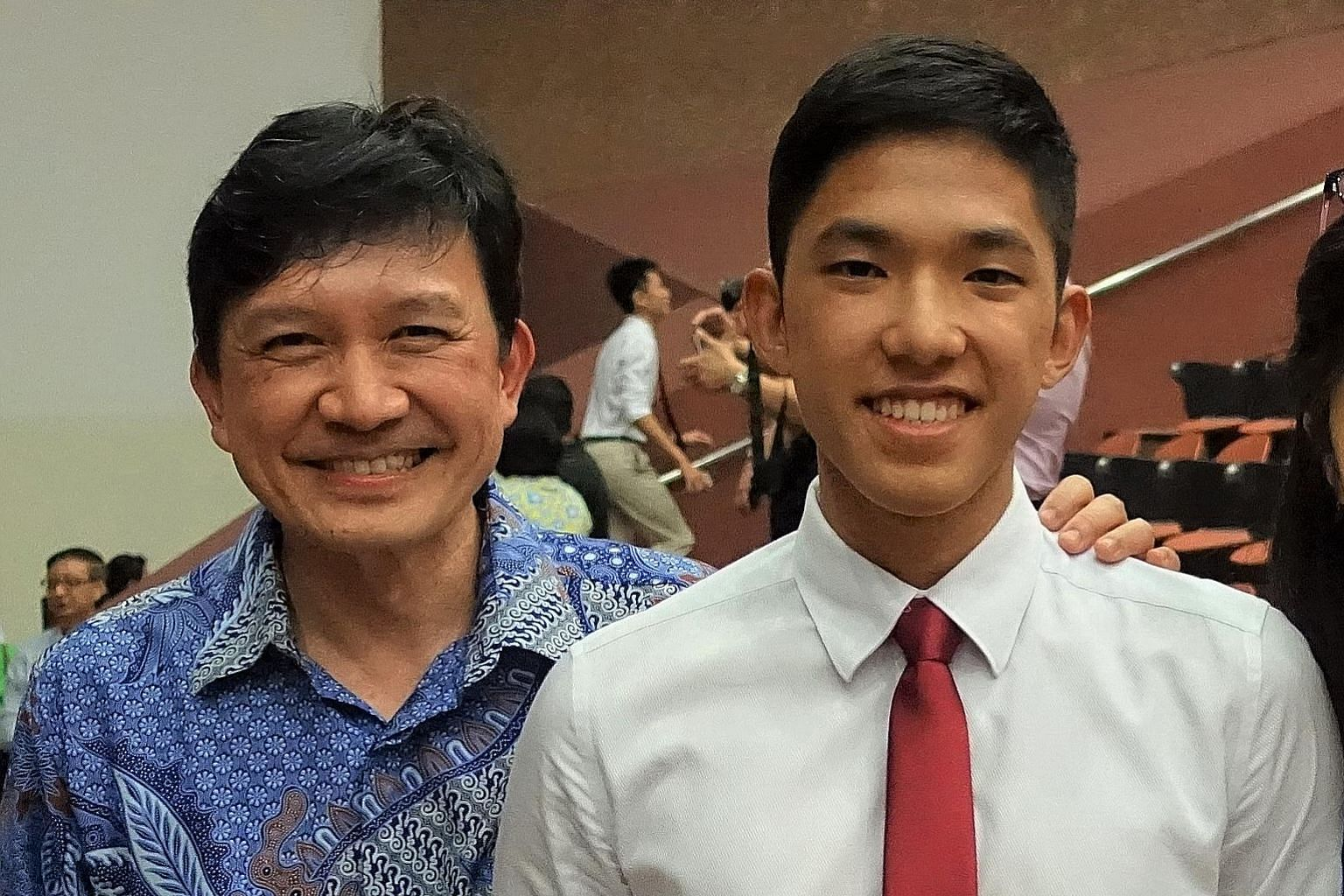 Dentist Tan Peng Hui, who rallied those in the dental industry to donate masks to nursing homes, with his son Caleb, a medical student who volunteered his help in the Covid-19 fight. PHOTO: COURTESY OF TAN PENG HUI