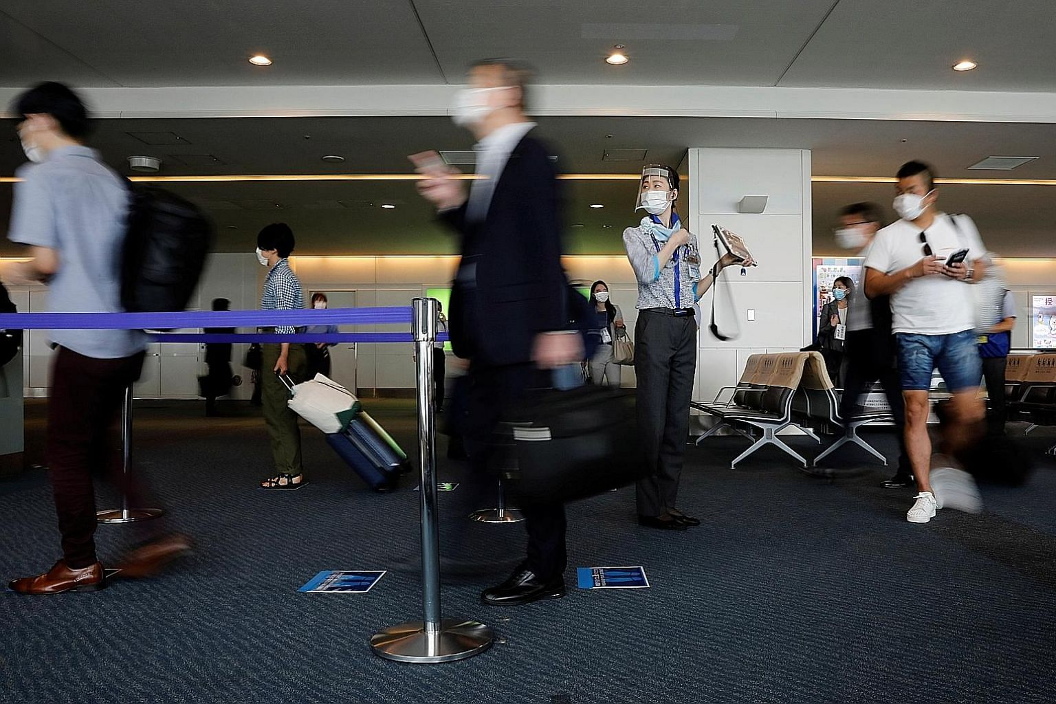 Tokyo's Haneda Airport pictured early this month. Prime Minister Shinzo Abe announced plans to open Japan's borders to business tourists, initially accepting up to 250 daily from countries with low infection rates. PHOTO: REUTERS
