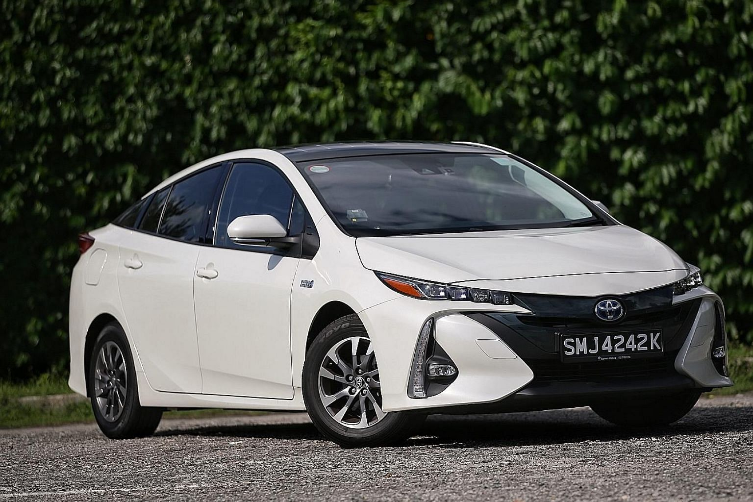 Through the centre-console display, the Toyota Prius PHV (above) is able to provide information of the distances covered in electric and petrol mode for every recent trip.