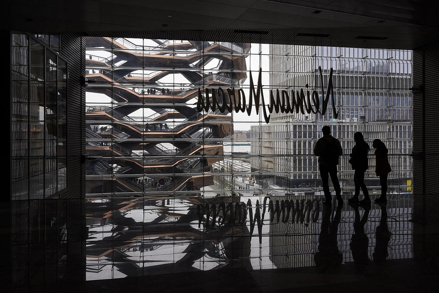 The 11ha Hudson Yards (above and left) in Manhattan has helped define the live-work-play ethos that many younger professionals seek in cities. But such mixed-use malls have suffered from measures imposed to curb the coronavirus pandemic PHOTOS: NYTIM