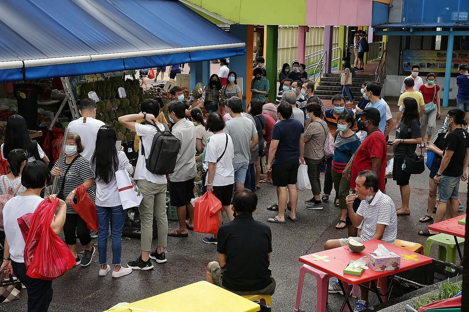 As some queue at their favourite stalls at Tiong Bahru Market hawker centre, others eagerly tuck into their breakfast after so many weeks of not being able to have meals at eateries. People queueing at the Din Tai Fung restaurant at Jem shopping mall