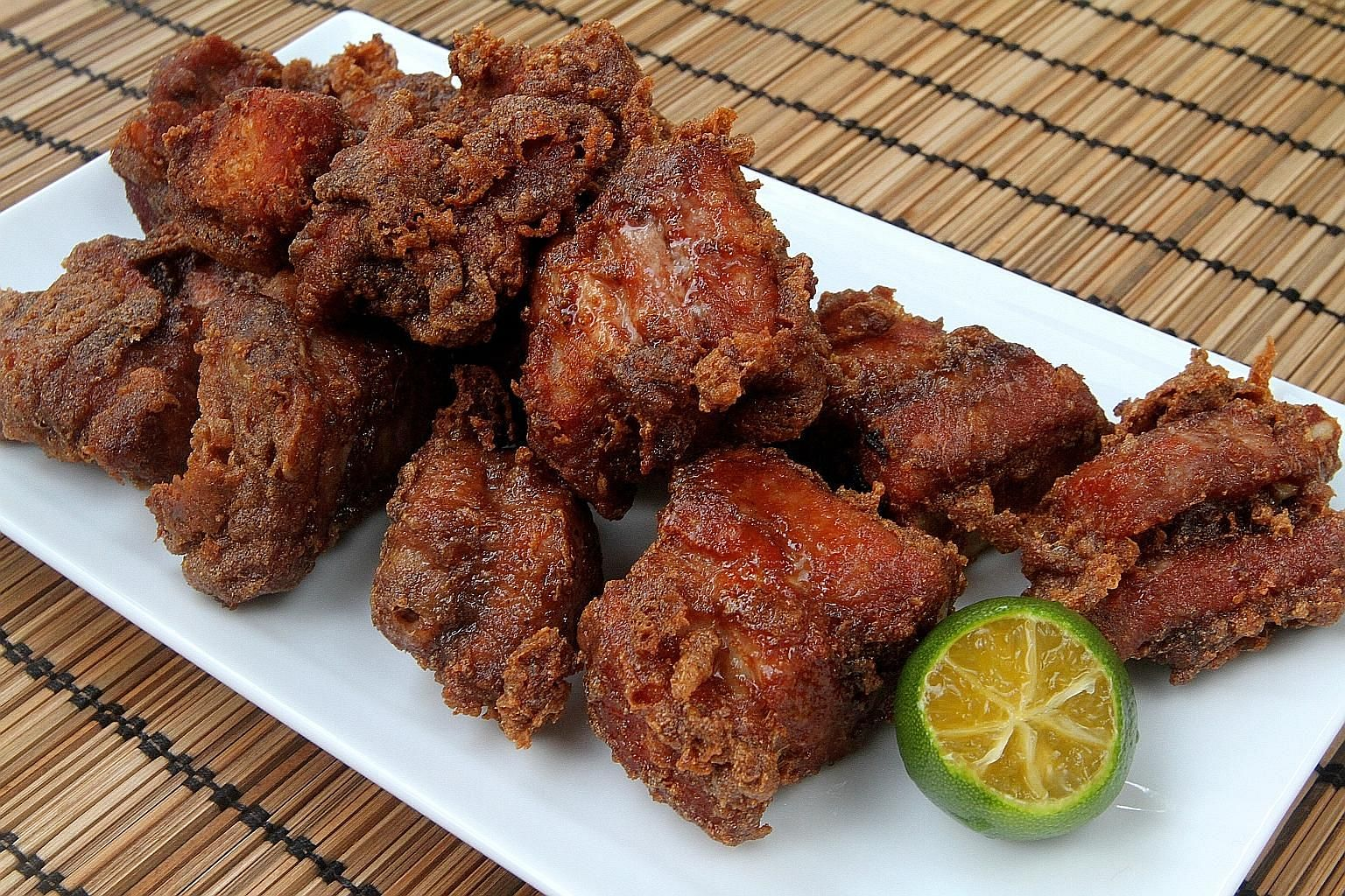 For flavourful har cheong (prawn paste) ribs, marinate the meat for four hours.