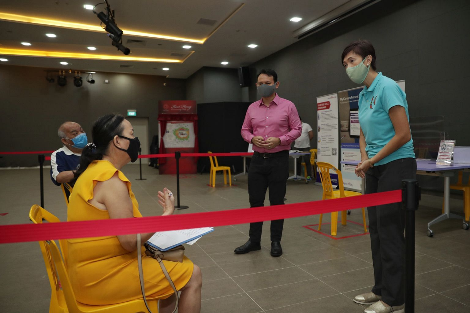 Manpower Minister Josephine Teo and Minister of State for Manpower Zaqy Mohamad speaking to job seeker Linda Chen, 60, at the SGUnited Jobs and Skills Centre at Keat Hong Community Club yesterday. ST PHOTO: GIN TAY