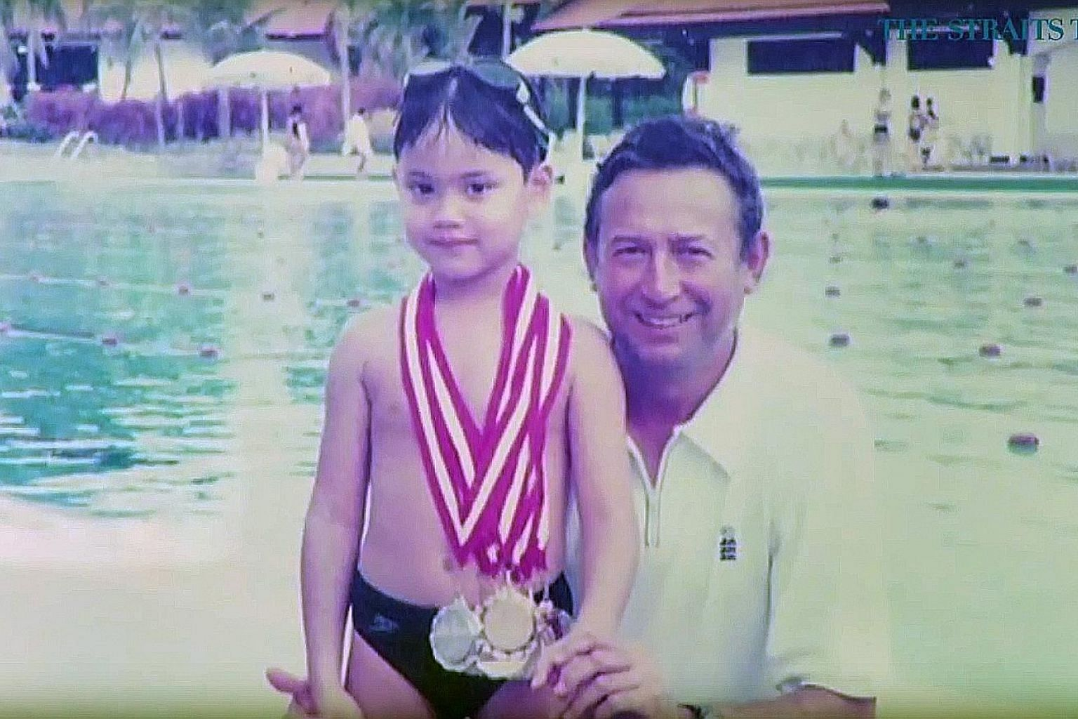 A young Joseph Schooling and his father Colin after a swimming meet in Singapore. With the support of his parents, the boy chased his dreams and made Olympic history. ST FILE PHOTO