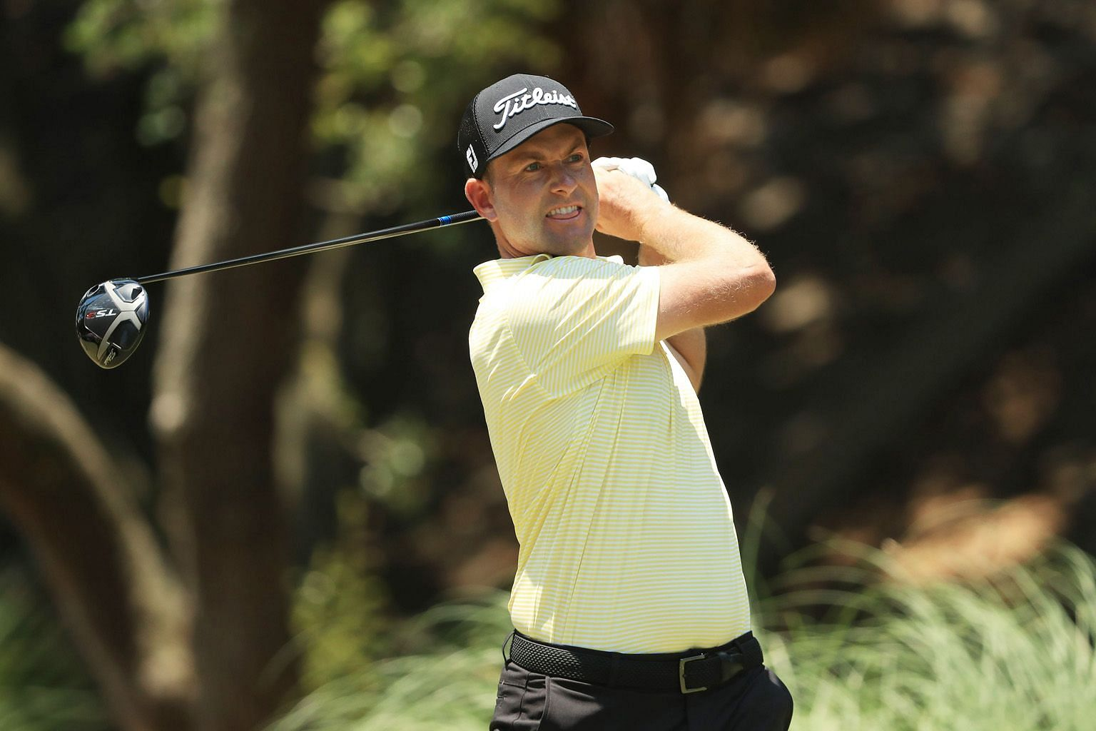 Webb Simpson playing his shot from the second tee in the final round of the RBC Heritage on Sunday at Harbour Town Golf Links. He came from behind on the back nine and made five birdies over his final seven holes to win by a stroke. PHOTO: AGENCE FRA