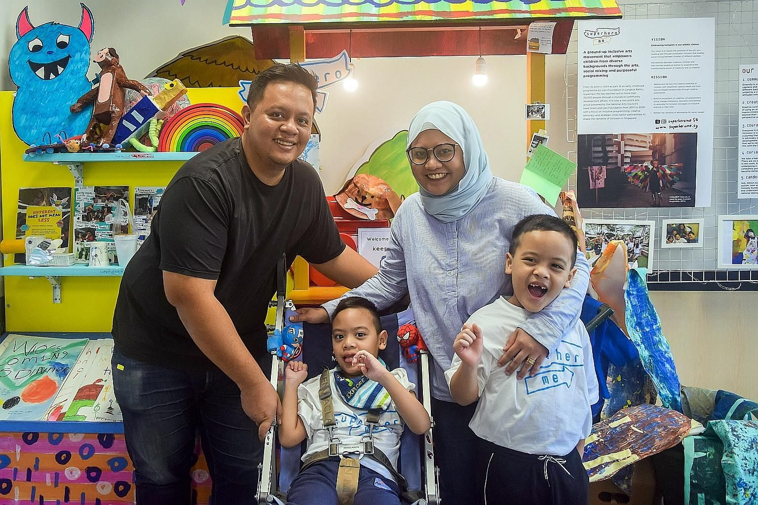 """Twin brothers Rizq Nawfal Hambril (seated) and Qays Naushad Hambril with their parents, Mr Hambril Burham, 36, and Ms Nur Hidayah Shahrudin, 33. PHOTOS: NDP2020 EXCO The twin brothers' design titled """"Eat, Play, Repeat"""" features imagery of things they"""