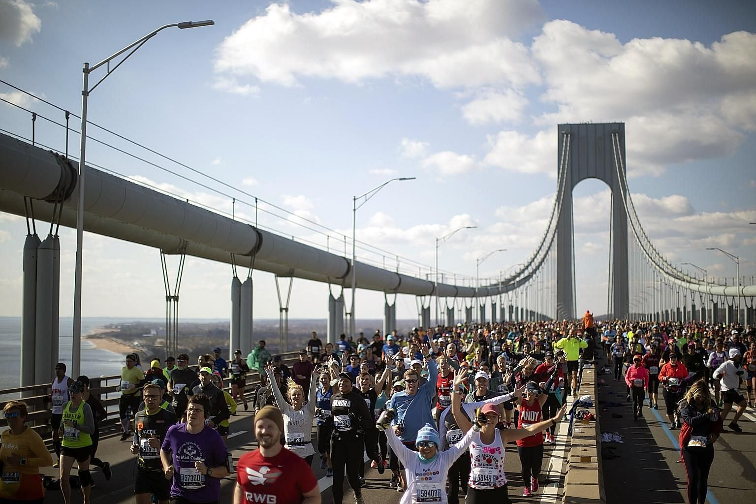Runners crossing the iconic Verrazzano-Narrows Bridge during last year's New York City Marathon. The world's largest marathon was cancelled due to concerns about holding the race while coronavirus infection remains a risk in the city and elsewhere. P