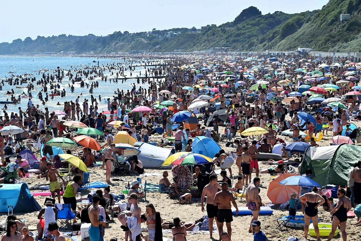 Bournemouth beach in England (above) was packed on Thursday as people celebrated the end of lockdown. Other beaches, including Southend in Essex (below), also drew large crowds - and official warning over the risks of Covid-19 infections.