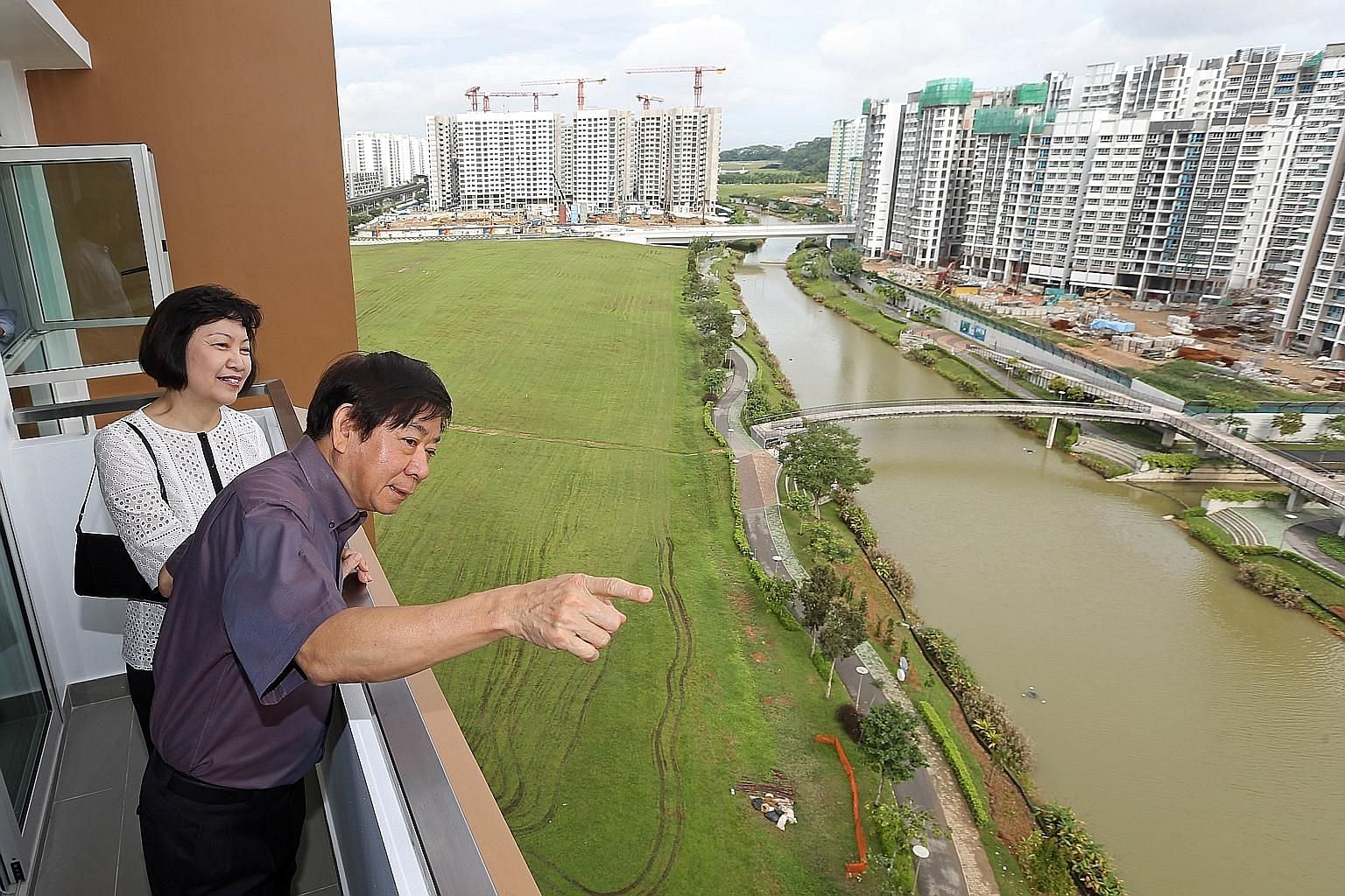 Mr Khaw Boon Wan previously served as national development minister when housing was a hot-button issue. He is seen here in a 2014 file photo with HDB CEO Cheong Koon Hean viewing the projects along Punggol Waterway. ST FILE PHOTO