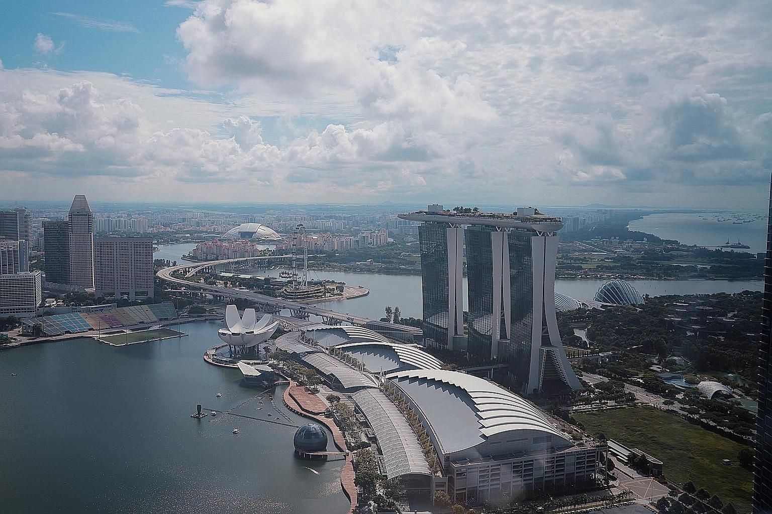 Singapore, the little red cork bobbing on the channel connecting the South China Sea and the Indian Ocean, faces complex external uncertainties as it goes into an election in times such as it has never seen before. ST PHOTO: JASON QUAH