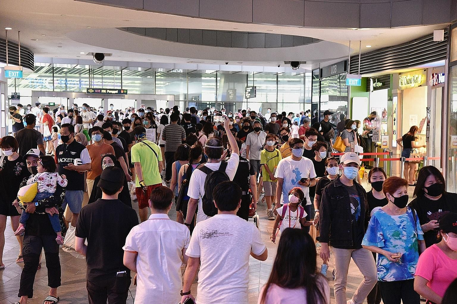 Shoppers at Waterway Point in Punggol last weekend, after Singapore moved into phase two of its reopening in the post-circuit breaker period. The Covid-19 pandemic shows no signs of slowing down across the world, with the number of cases approaching