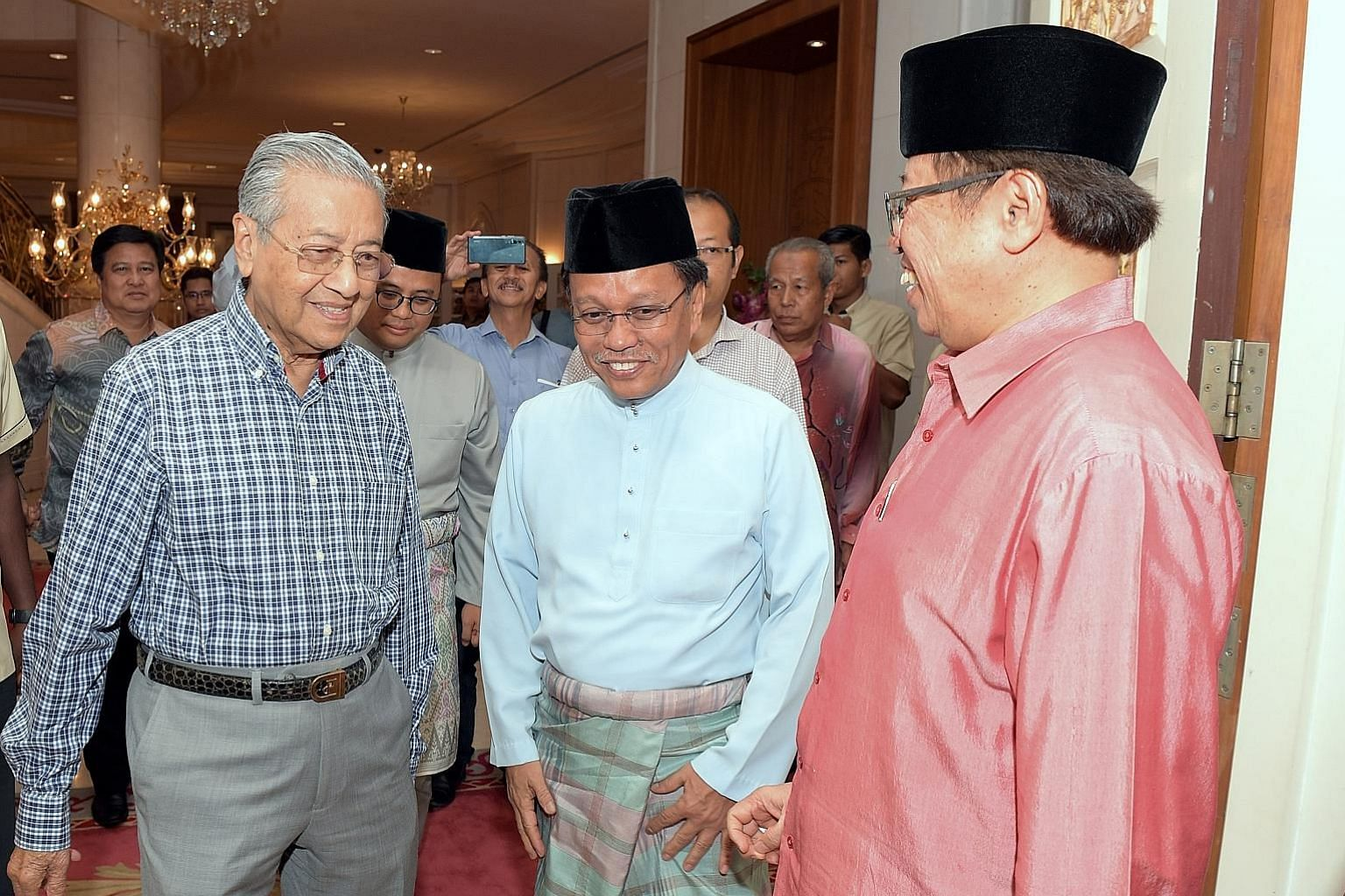 A June 2018 file photo of then Malaysian Prime Minister Mahathir Mohamad, Sabah Chief Minister Shafie Apdal (centre) and Sarawak Chief Minister Abang Johari Tun Openg (right) at an event in Putrajaya. Dr Mahathir said yesterday that Pakatan Harapan P