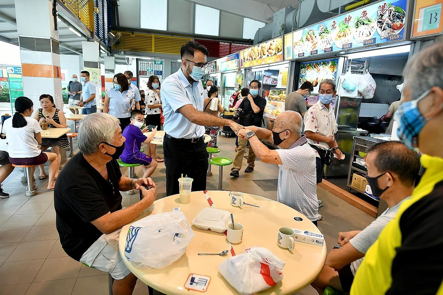 Workers' Party (WP) chief Pritam Singh greeting Bedok residents during the party's walkabout yesterday at the Bedok North Market and Food Centre. WP has revealed the identities of its candidates in only Aljunied GRC and Hougang SMC so far.