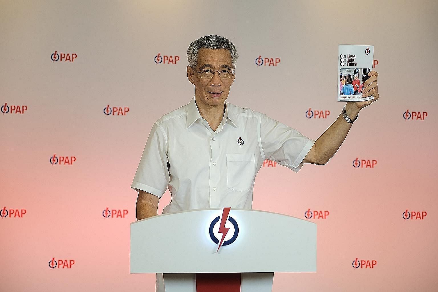 Prime Minister Lee Hsien Loong launching the People's Action Party's manifesto yesterday. During a live broadcast on Facebook and YouTube, he highlighted the achievements of a few of the PAP's new candidates, several of whom have founded social enter