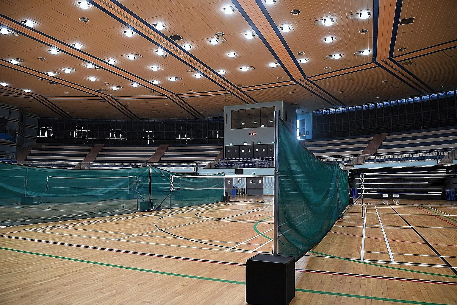 Mesh dividers between badminton courts at Jurong East Indoor Sports Hall, which was closed over the weekend. Of the 29-member group, over half are quarantined with the rest under phone surveillance.