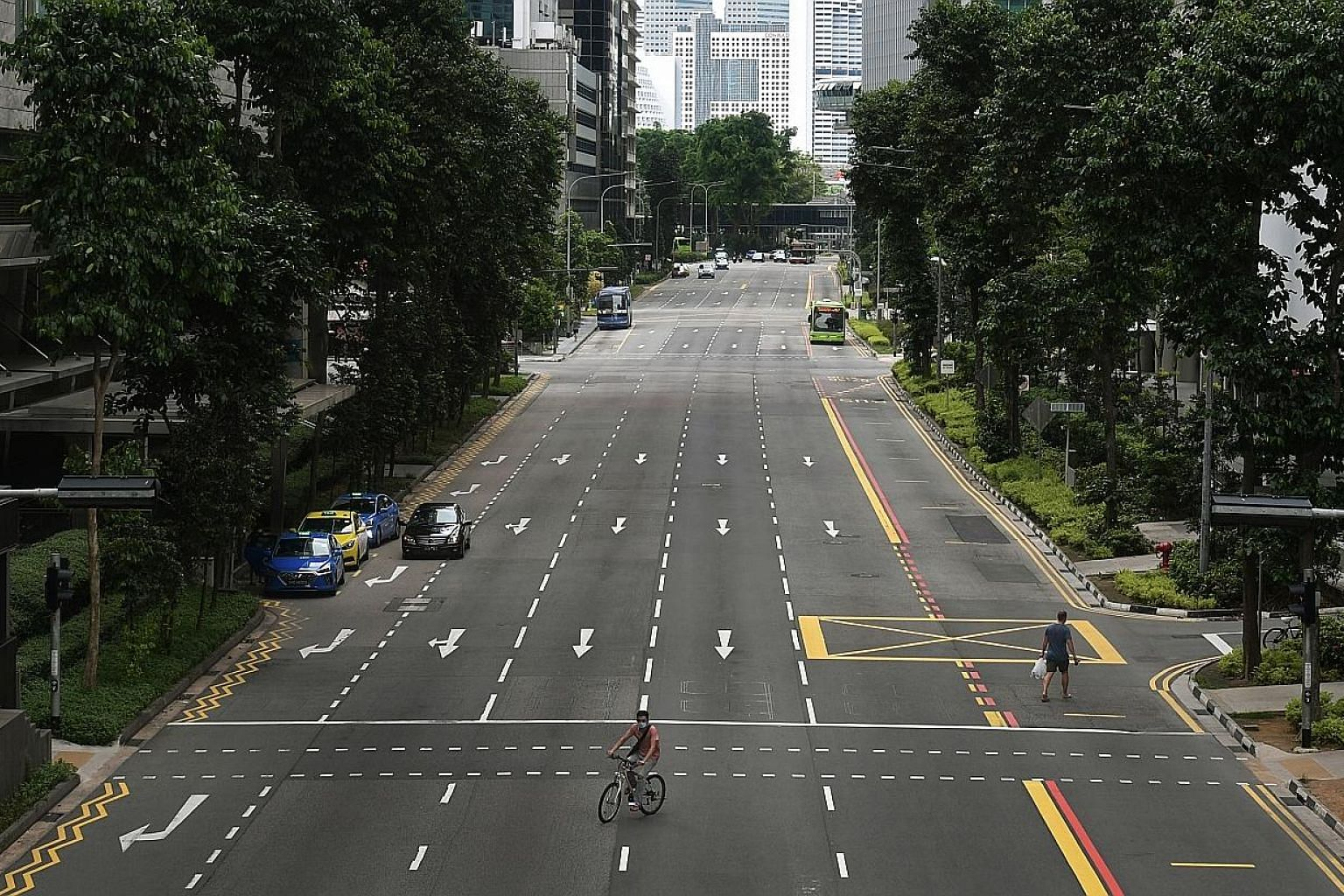 A deserted Shenton Way in the Central Business District in April, during the circuit breaker period. Even as Singapore gradually reopens its economy, it seems many employees, at the urging of the authorities, are in no rush to return to their offices