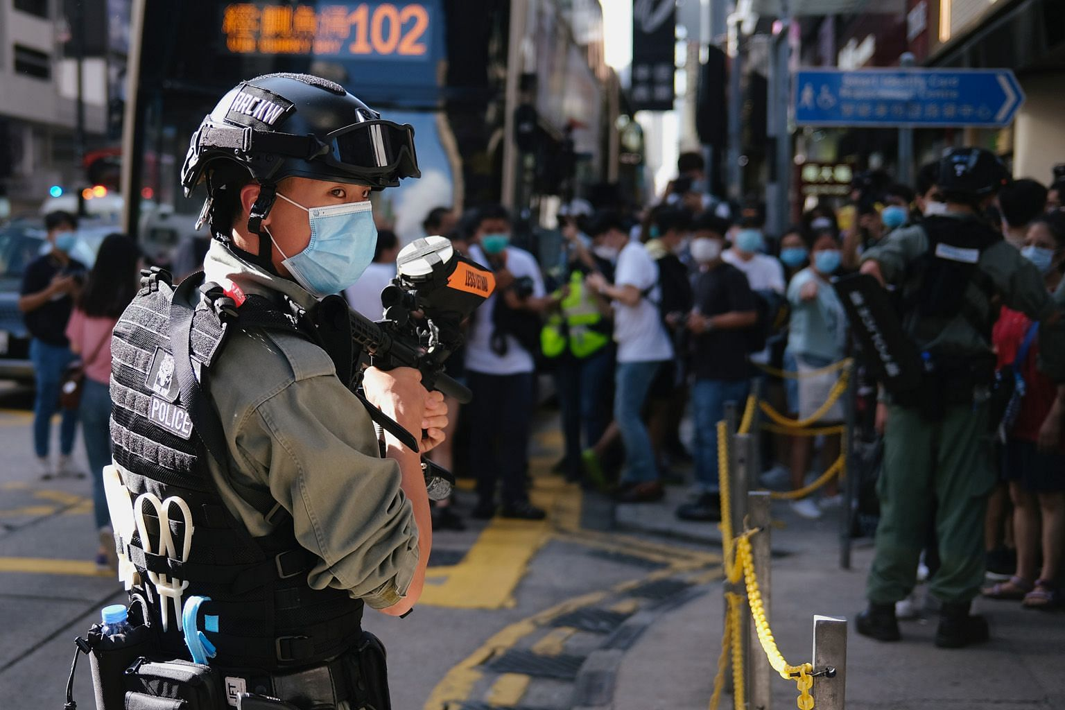 A riot police officer standing guard to prevent mass gatherings during a protest against the looming national security legislation in Hong Kong yesterday.