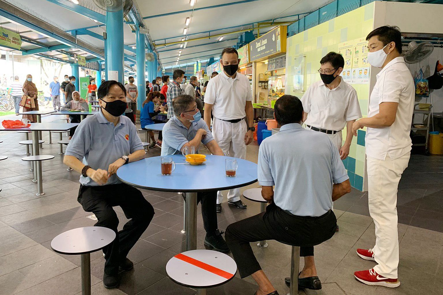 PAP's new candidate Desmond Tan greeting a resident at Loyang Point shopping mall yesterday. With him were fellow new face Mohamed Sharael Mohd Taha (second from right) and Mr Zainal Sapari (far right). PHOTO: TAMIL MURASU (From right) Speaker of Par