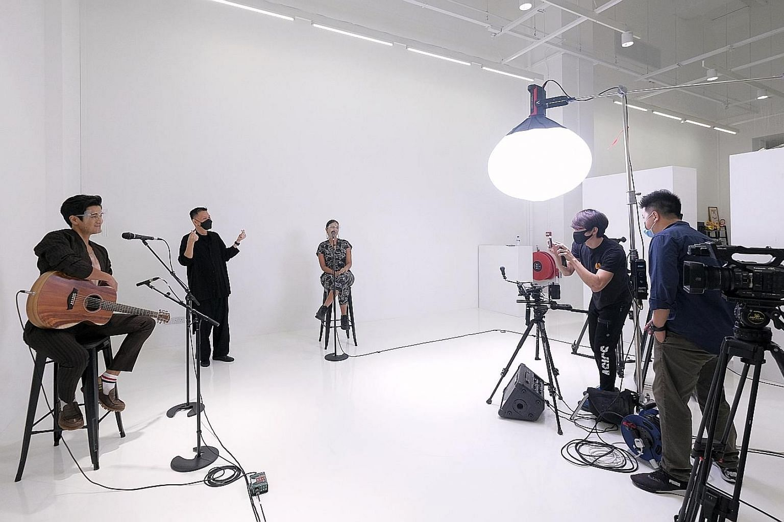Singers such as Nathan Hartono, Abby Simone (both above), Jasmine Sokko (left) and Benjamin Kheng (left, below) filming for the upcoming ChildAid 2020 - Virtually Yours concert.