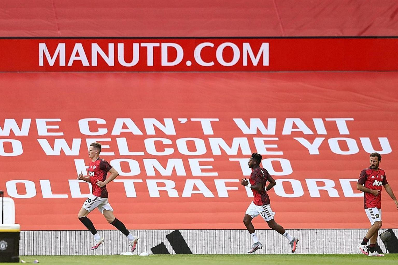 Manchester United players Scott McTominay, Fred and Juan Mata warming up for a match at Old Trafford. The Red Devils resume their push for a top-four place in the Premier League with an away game at Brighton today. PHOTO: REUTERS