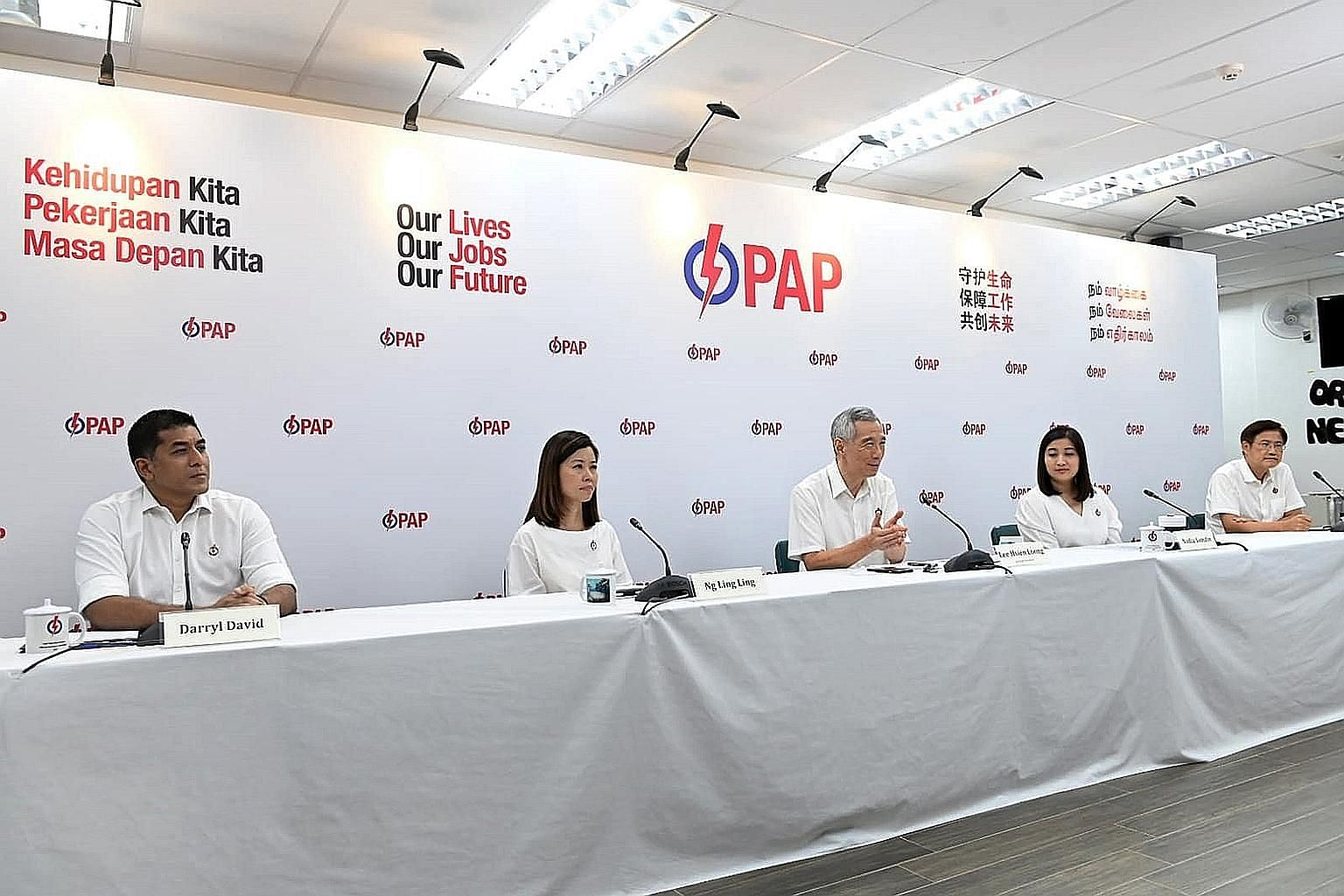 Prime Minister Lee Hsien Loong at yesterday's unveiling of candidates for Ang Mo Kio GRC, which he helms. The other members of the PAP's team in Ang Mo Kio GRC are (from left) Mr Darryl David, Ms Ng Ling Ling, Ms Nadia Ahmad Samdin and Mr Gan Thiam P