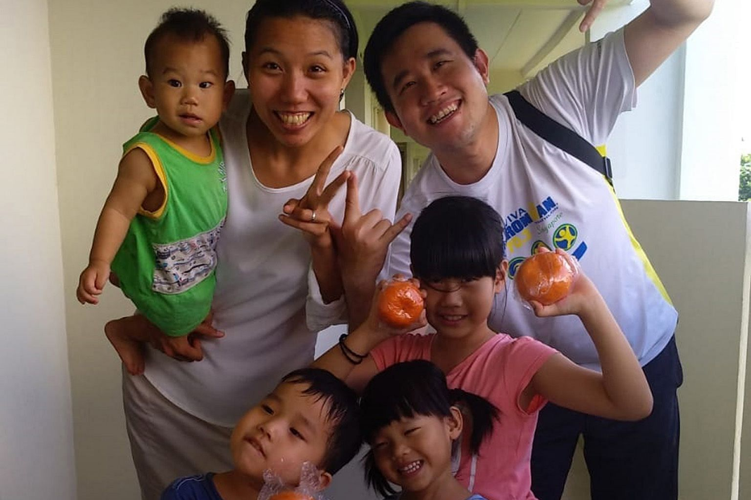 Research engineer Benjamin Lim, 32, with Mrs Lim, a housewife, and their four children. He was not aware of how the Child Development Account First Step grant could be utilised until the People's Association contacted him recently. PHOTO: COURTESY OF