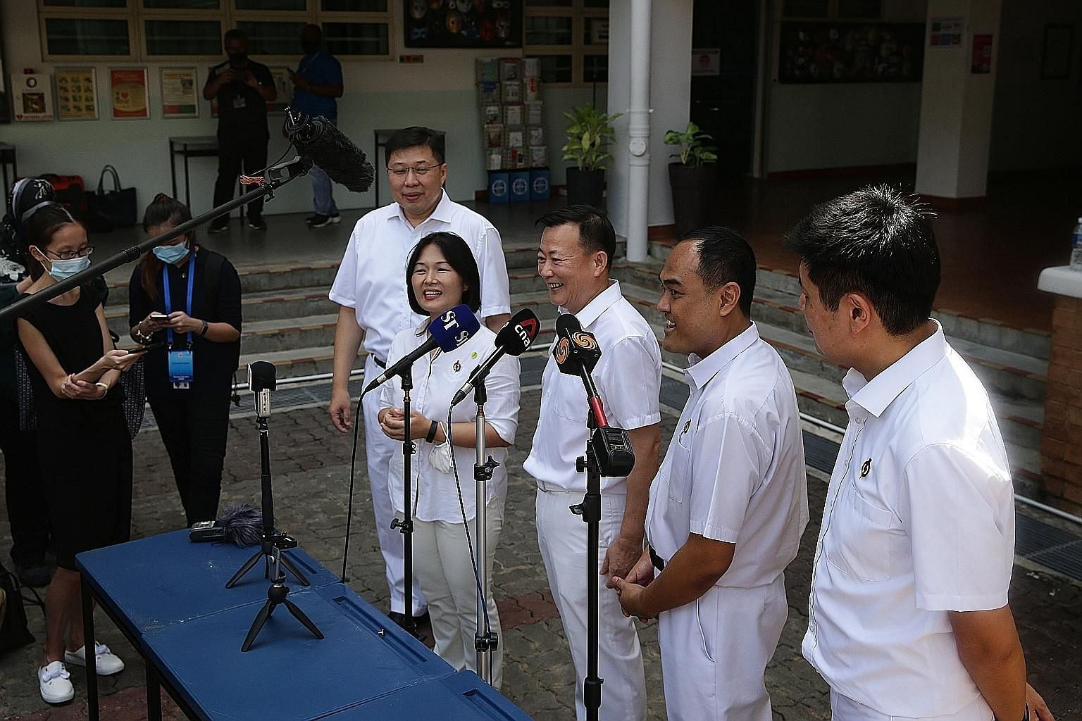 Workers' Party chief Pritam Singh and chairman Sylvia Lim speaking to the media with fellow Aljunied GRC candidates (from left) Leon Perera, Faisal Manap and Gerald Giam at Deyi Secondary School yesterday. The WP has fielded its strongest slate in th