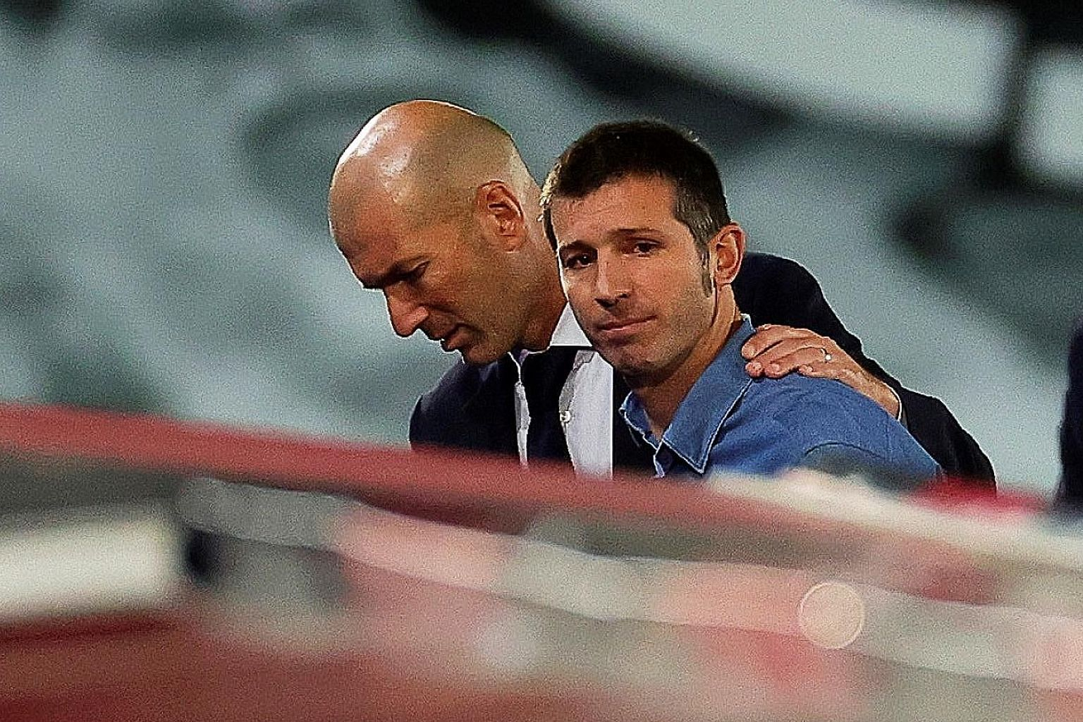 Valencia coach Albert Celades with Real Madrid's Zinedine Zidane after Real's 3-0 La Liga win on June 18. Celades was sacked on Monday. PHOTO: EPA-EFE