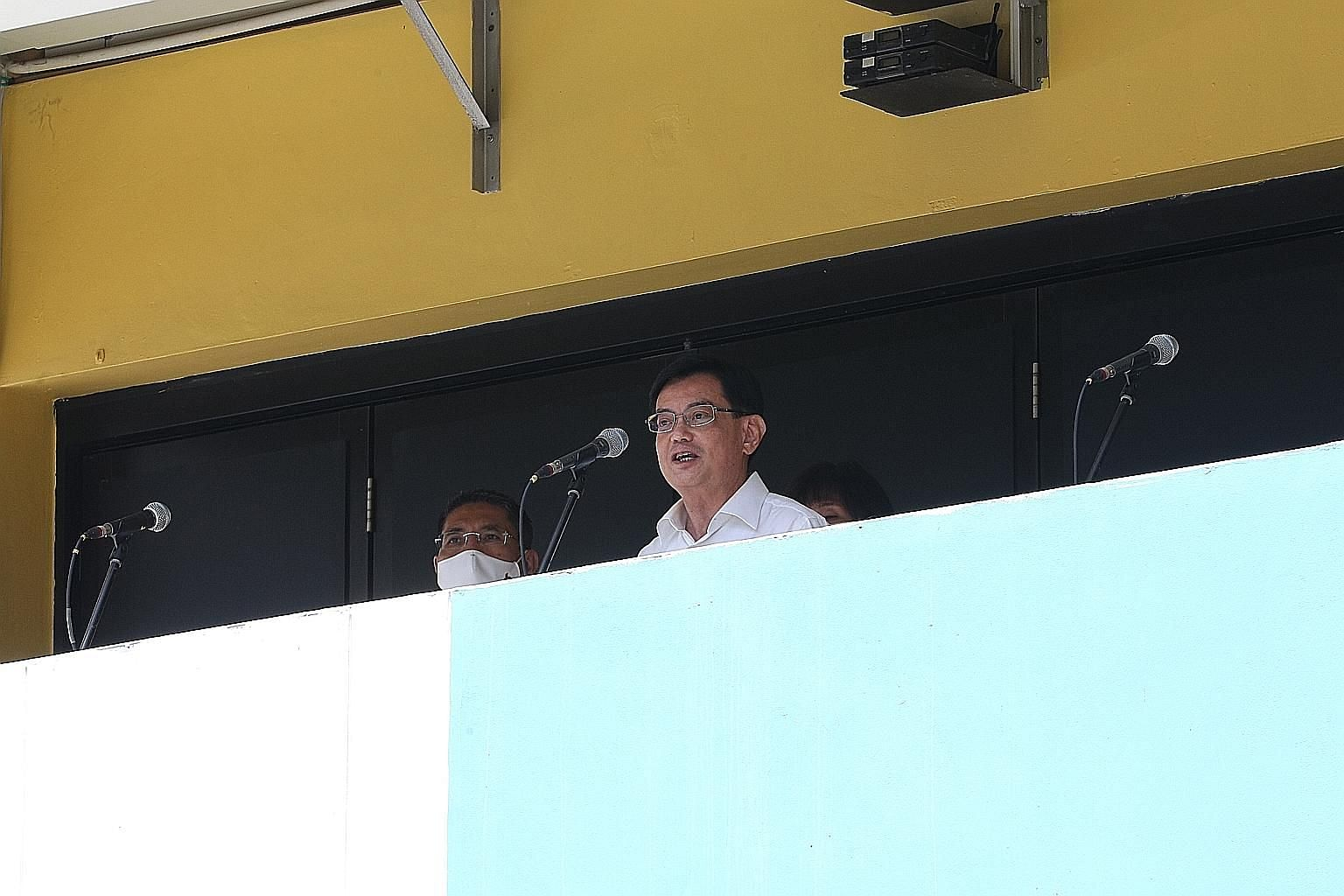 Deputy Prime Minister Heng Swee Keat speaking at St Anthony's Canossian Primary School yesterday. He said on Facebook that the PAP cannot afford a gap in East Coast GRC in these uncertain times, and a full team is needed to take care of the residents