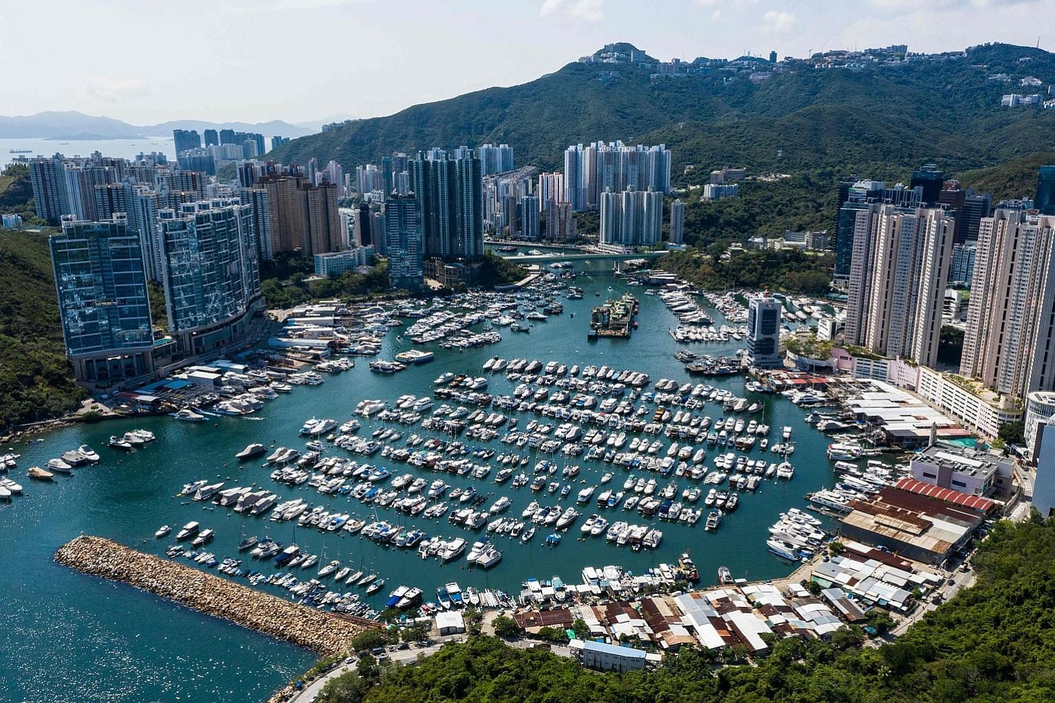 Residential buildings in Aberdeen Harbour, Hong Kong. Gains in home prices were helped by low interest rates and pent-up demand as the economy gradually picked up after the Covid-19 outbreak. PHOTO: AGENCE FRANCE-PRESSE
