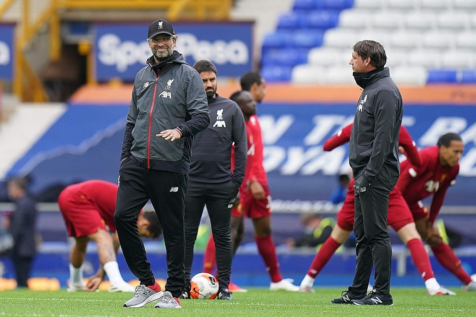 Liverpool's German manager Jurgen Klopp overseeing the warm-up before their match against Everton at Goodison Park on June 21. The Reds won the league with seven games to spare - a record.
