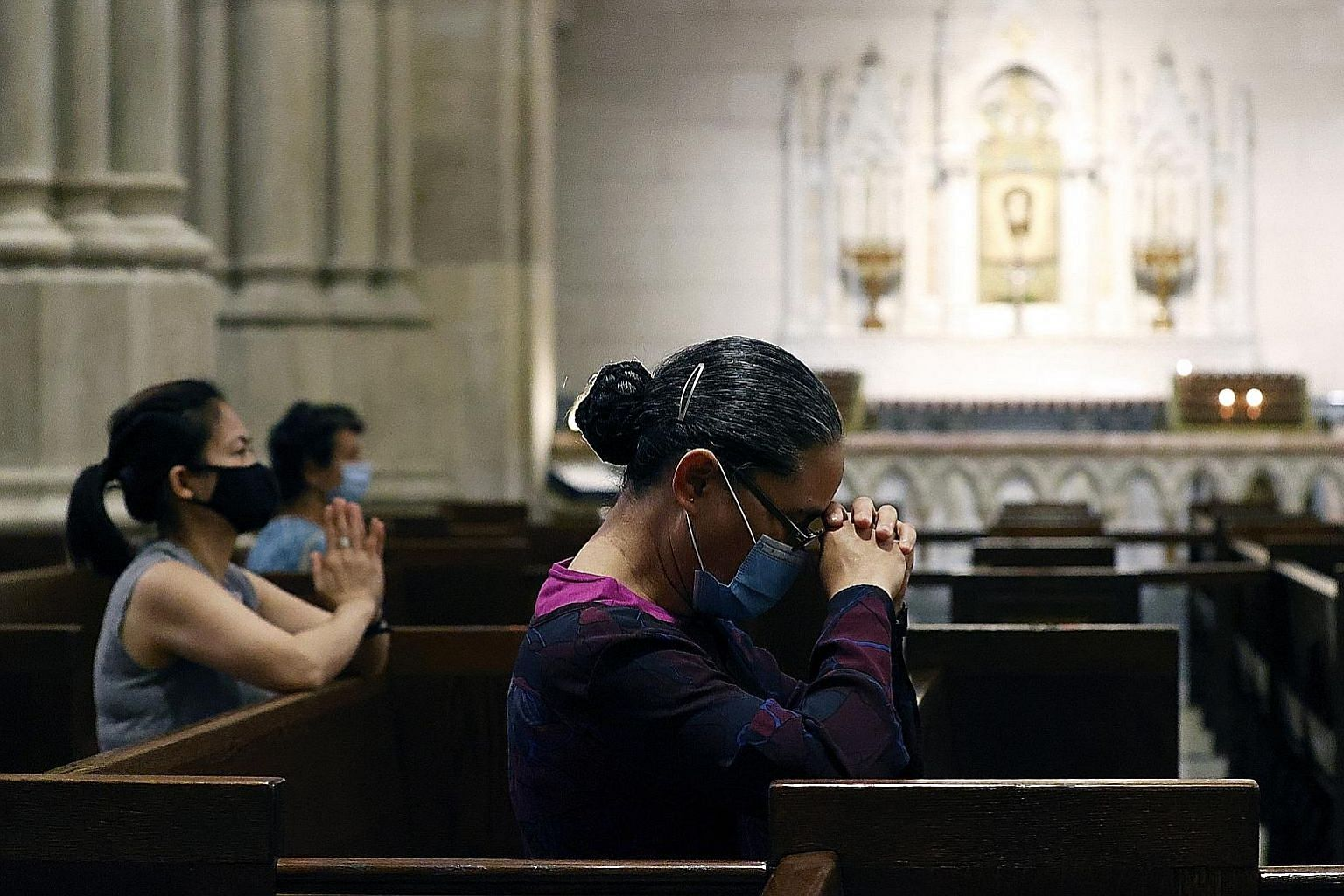 St Patrick's Cathedral holding its first public mass since March with a limited number of parishioners in New York last Sunday. It had stopped in-person attendance because of the coronavirus pandemic, which shut down public worship at mosques, temple