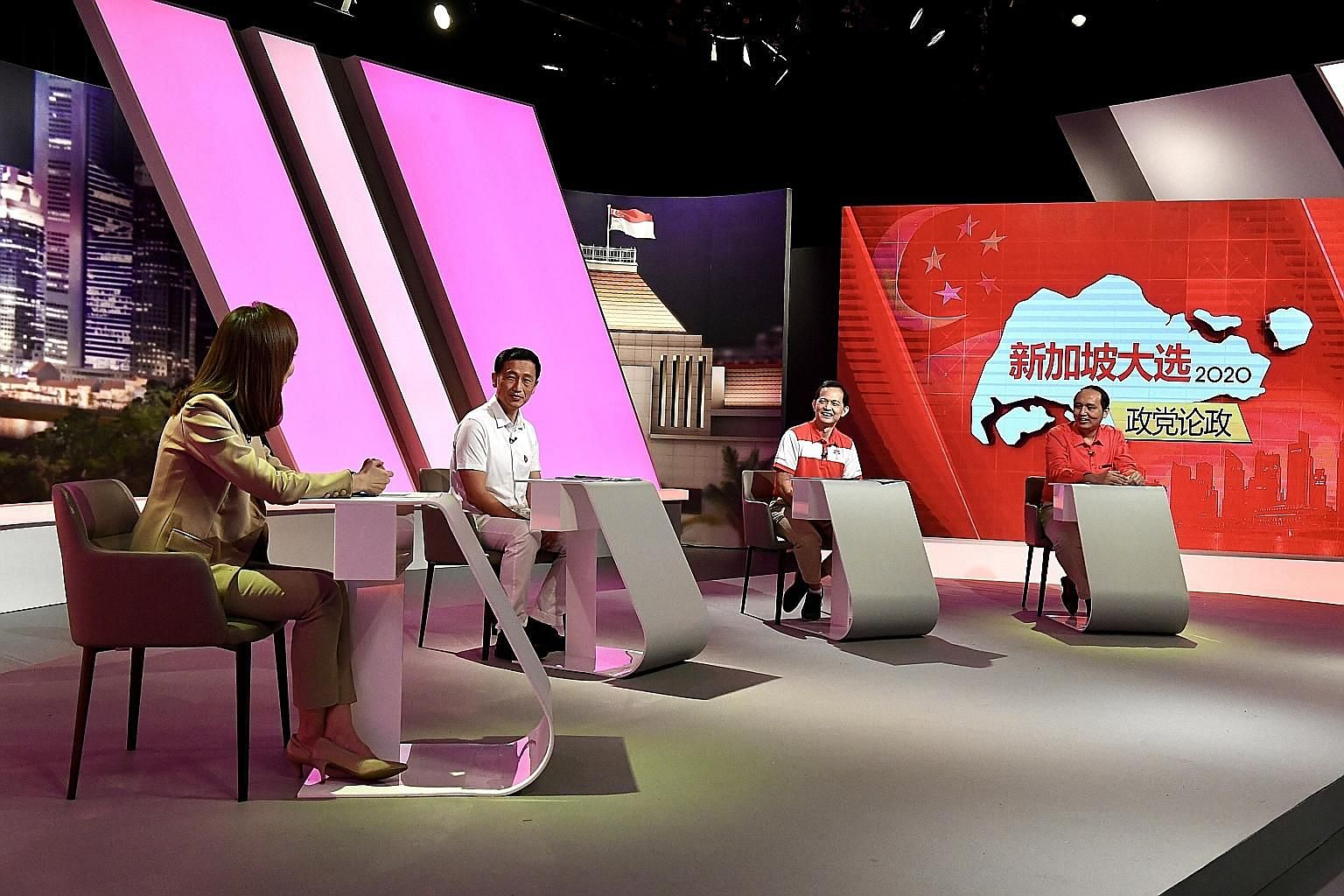 (From left) Mediacorp presenter Tung Soo Hua moderating a live televised political debate in Mandarin with the PAP's Ong Ye Kung, PSP's Leong Mun Wai and SDP's Brian Lim.