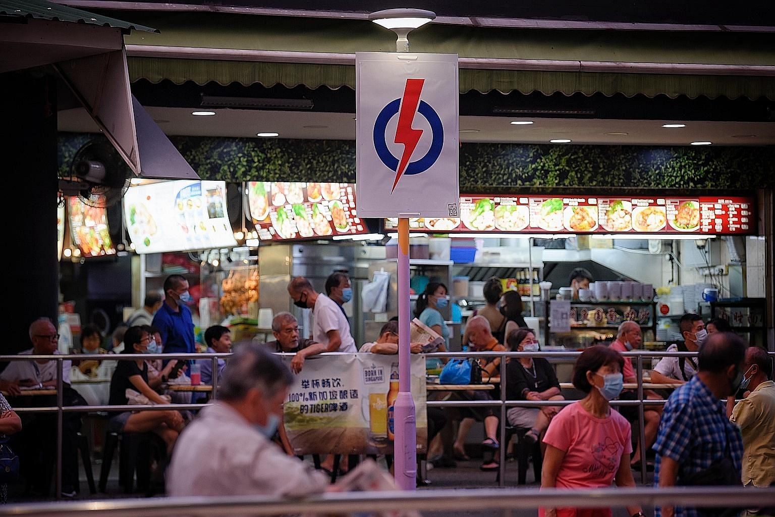 A PAP logo outside a coffee shop at Ang Mo Kio Town Centre. Deputy Prime Minister Heng Swee Keat said that the ruling party is seeking a clear mandate to lead Singapore through the storms ahead. ST PHOTO: MARK CHEONG