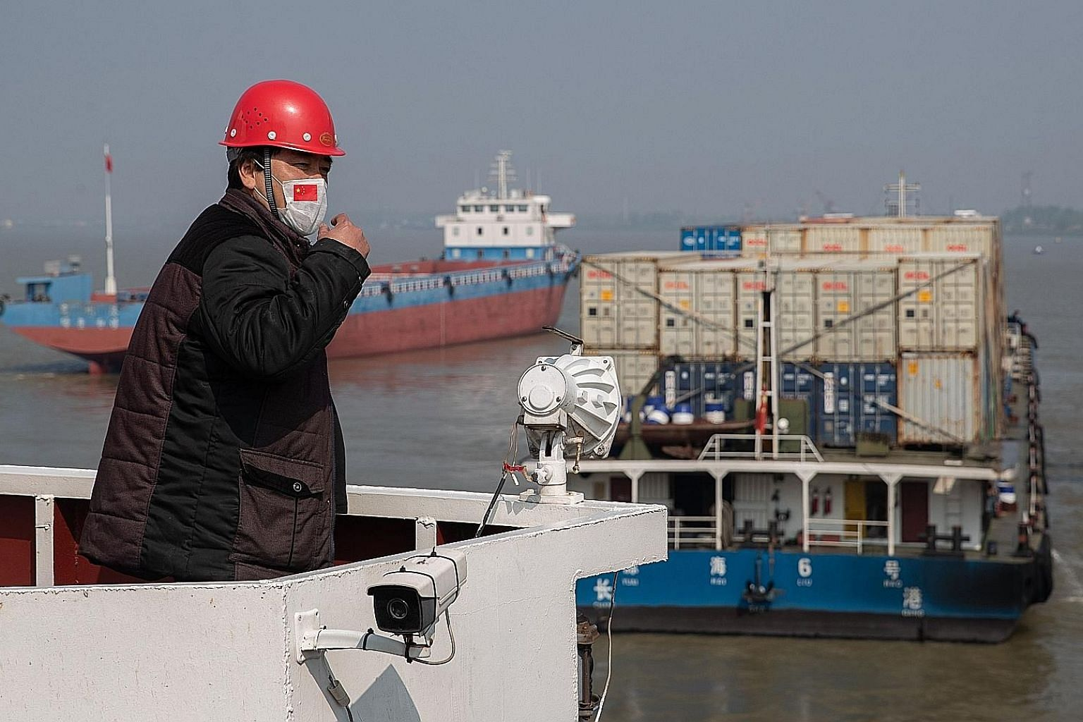 Container ships at the port of Wuhan. China is the 12th country to sign a pact launched by Singapore and New Zealand to uphold trade connections during the pandemic. PHOTO: AGENCE FRANCE-PRESSE