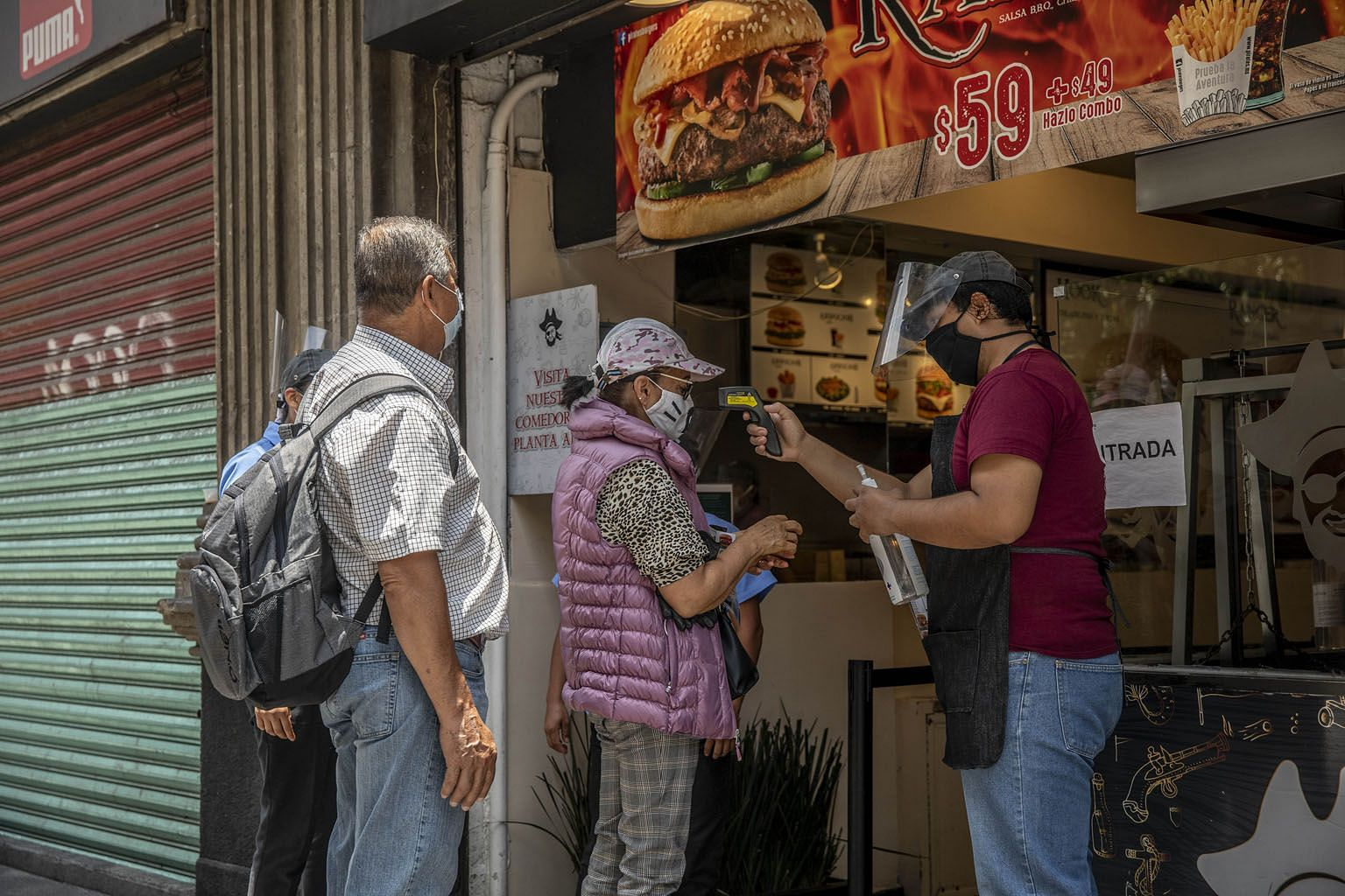 Customers outside a restaurant in Mexico City on Wednesday. The capital of Mexico began reopening businesses this week.