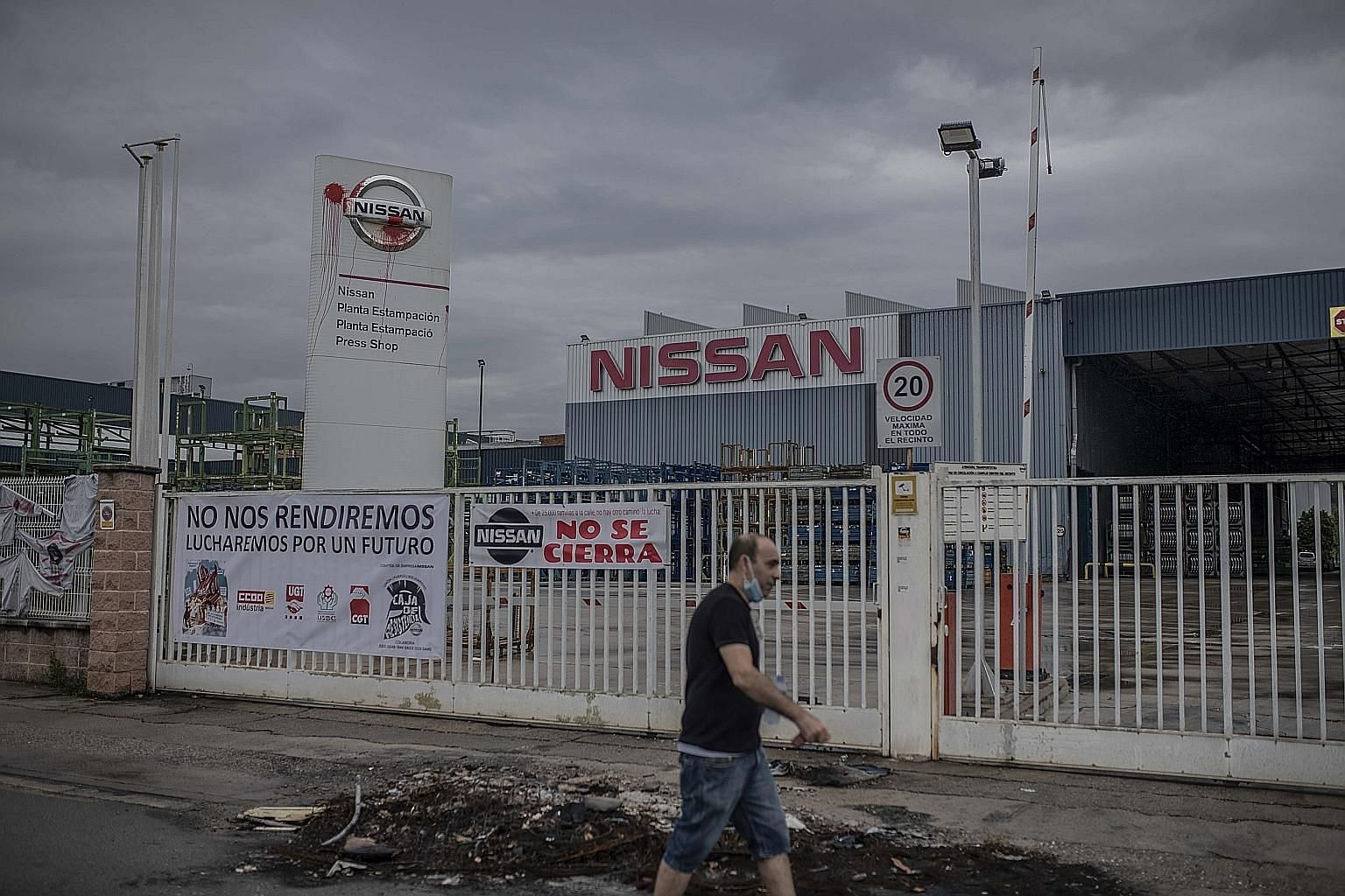 Red paint stained a logo by the closed gates of the Nissan Motor plant in the Montcada i Reixac district of Barcelona, Spain, last month. The carmaker confirmed in May it was closing its three plants in the industrial hub.