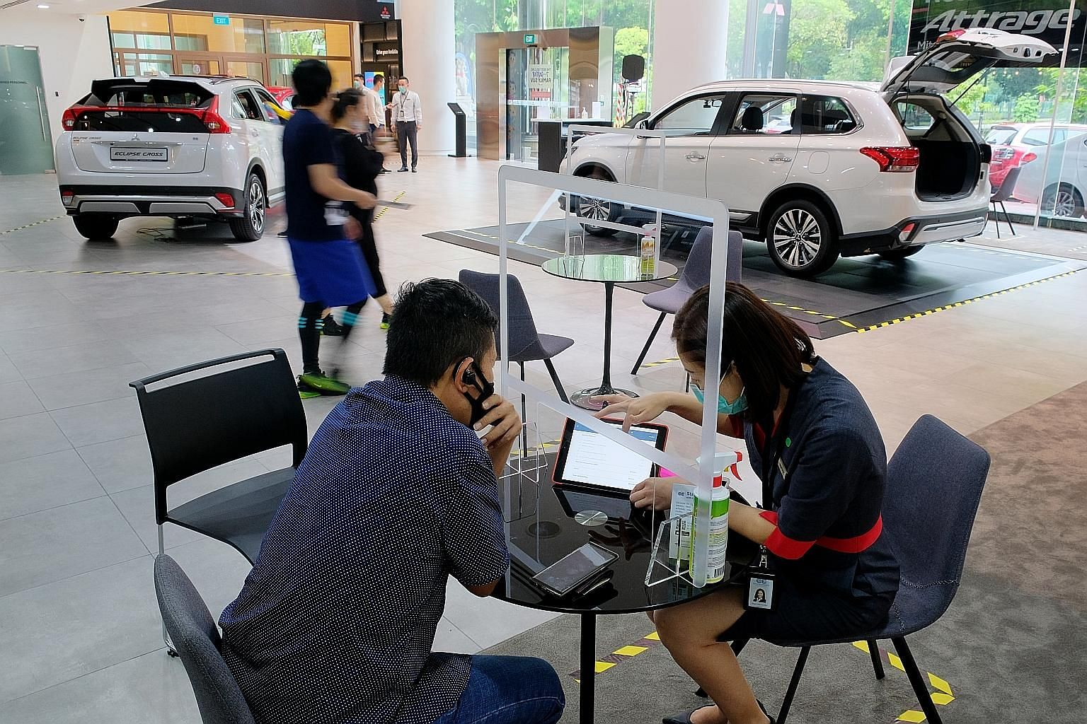 Car buyers at the Mitsubishi showroom in Leng Kee Road on June 20, a day after Singapore moved into phase two of its reopening post-circuit breaker.