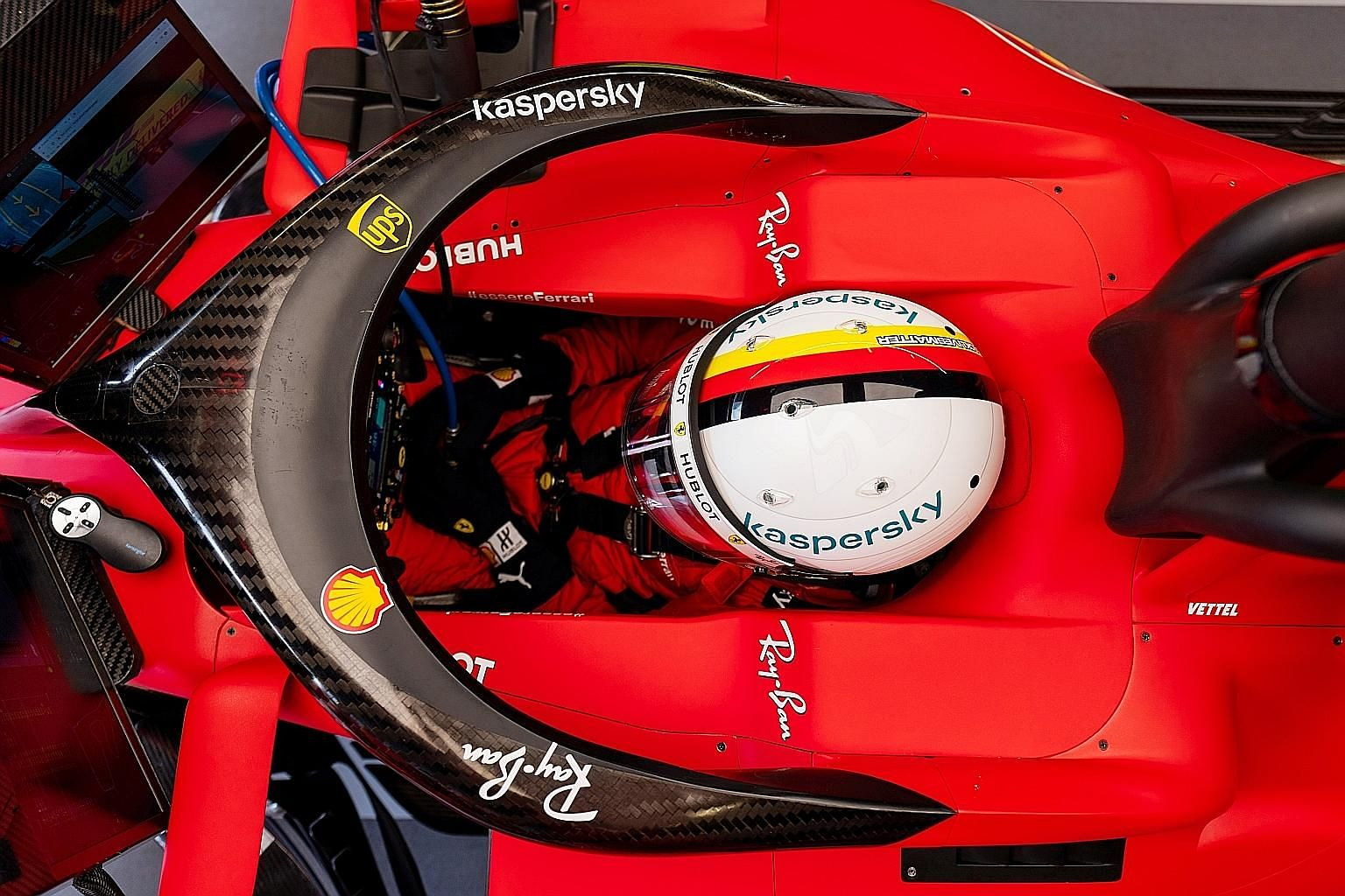 Sebastian Vettel waiting in the cockpit as his team prepare his Ferrari for the first practice of the Austrian Grand Prix at the Red Bull Ring yesterday. The F1 season, suspended just before the opening race in Melbourne in March, resumed behind closed do