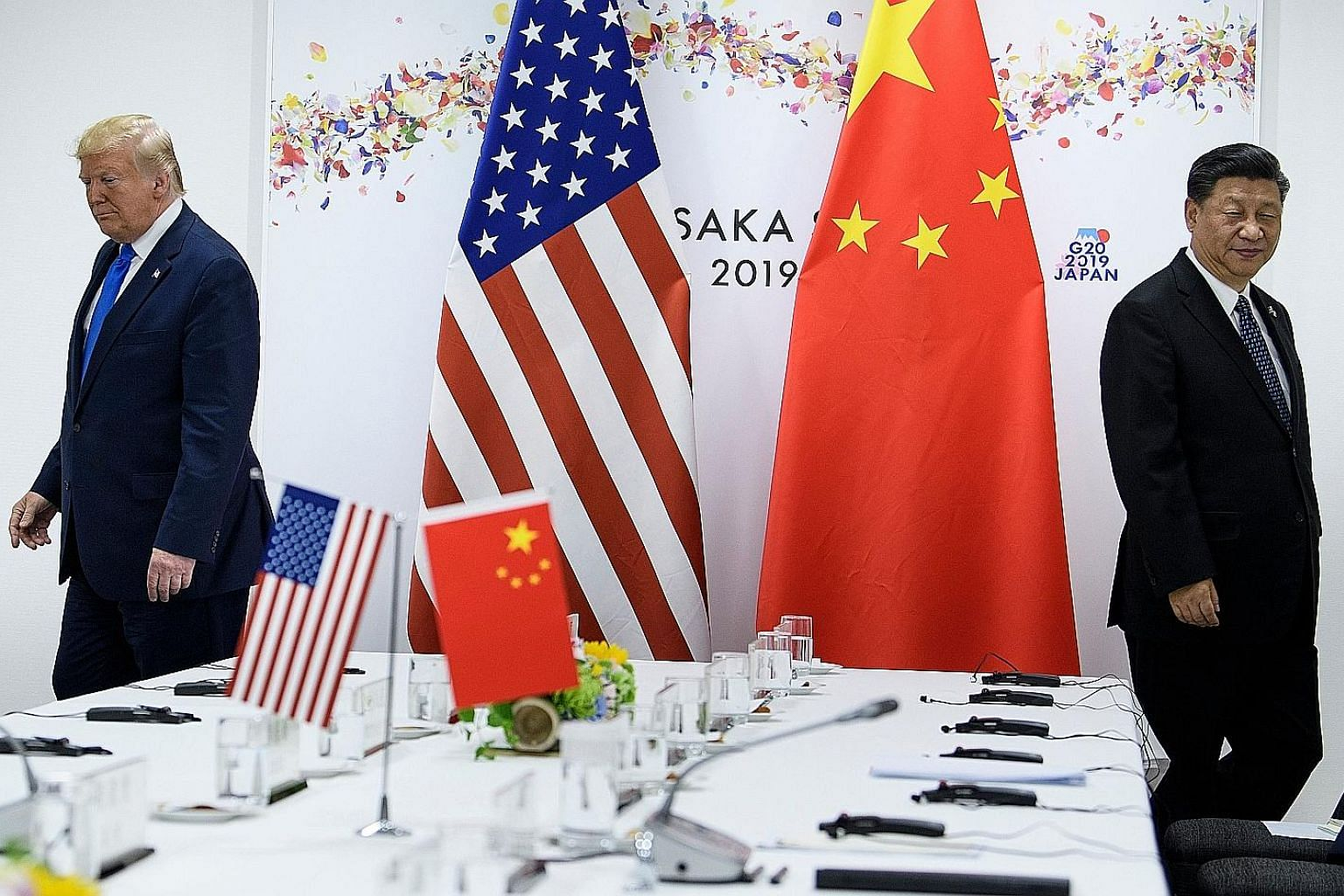 US President Donald Trump and China's President Xi Jinping at the Group of 20 summit in Osaka in June last year. The writer says that the unravelling of the existing world order started with the elections of these two leaders. PHOTO: AGENCE FRANCE-PR