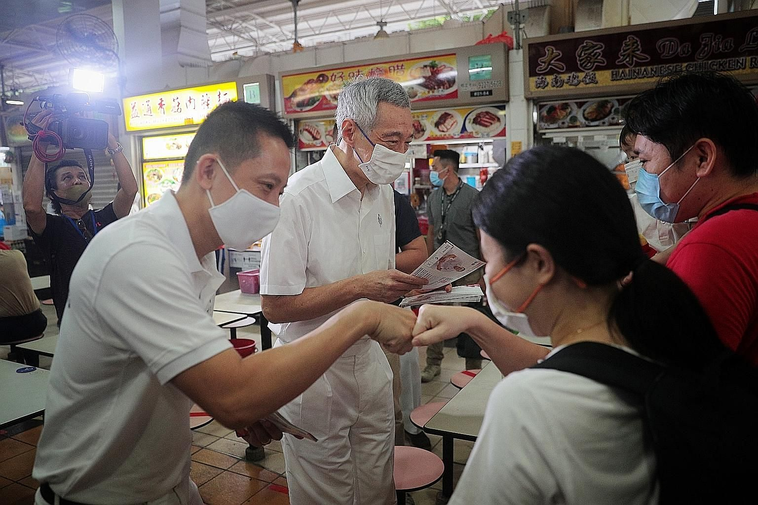PAP candidates for Bishan-Toa Payoh GRC (from right) Ng Eng Hen, who is Defence Minister, Saktiandi Supaat and Chong Kee Hiong on a walkabout in Toa Payoh Central on Thursday. ST PHOTO: SHINTARO TAY The PAP's candidate for Bukit Batok SMC Murali Pill