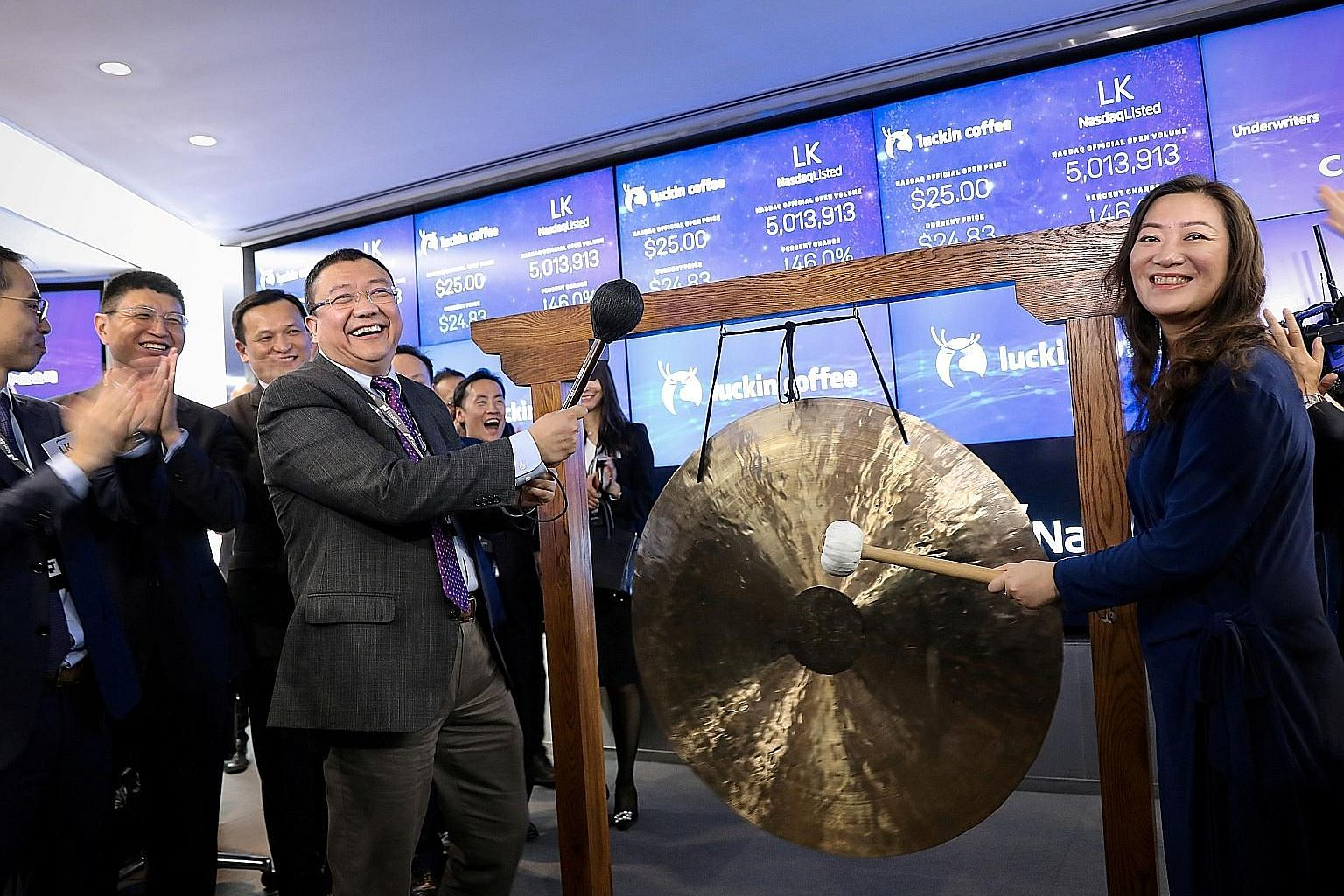 Luckin Coffee's chairman Charles Lu Zhengyao and then chief executive Jenny Qian Zhiya celebrating the company's initial public offering at the Nasdaq MarketSite in New York in May last year.