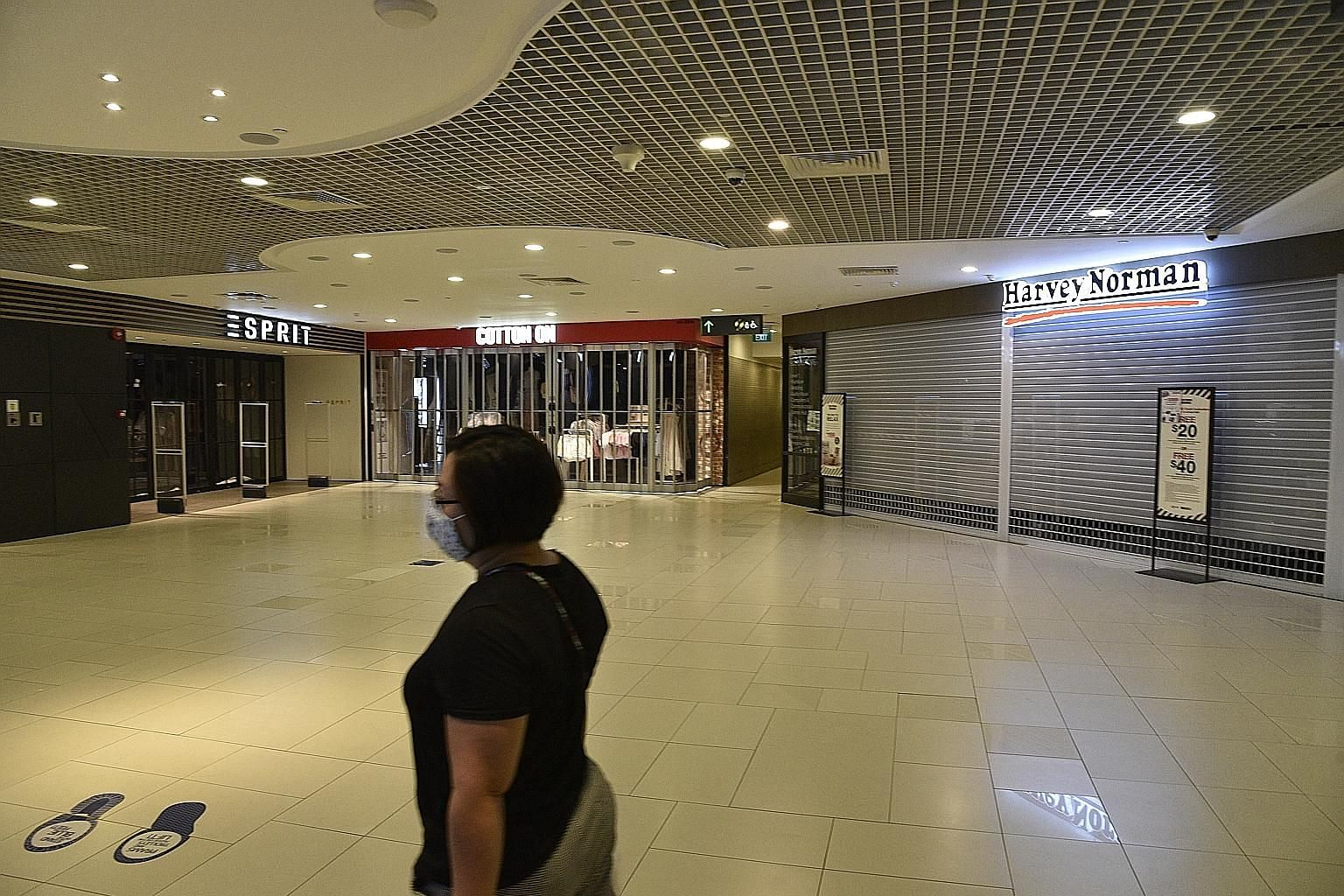 A near-empty Parkway Parade mall with most of its shops closed in May amid Singapore's circuit breaker. Retail sales that month suffered their biggest year-on-year fall since record-keeping began in 1986. Like in April, only two categories of retail sales