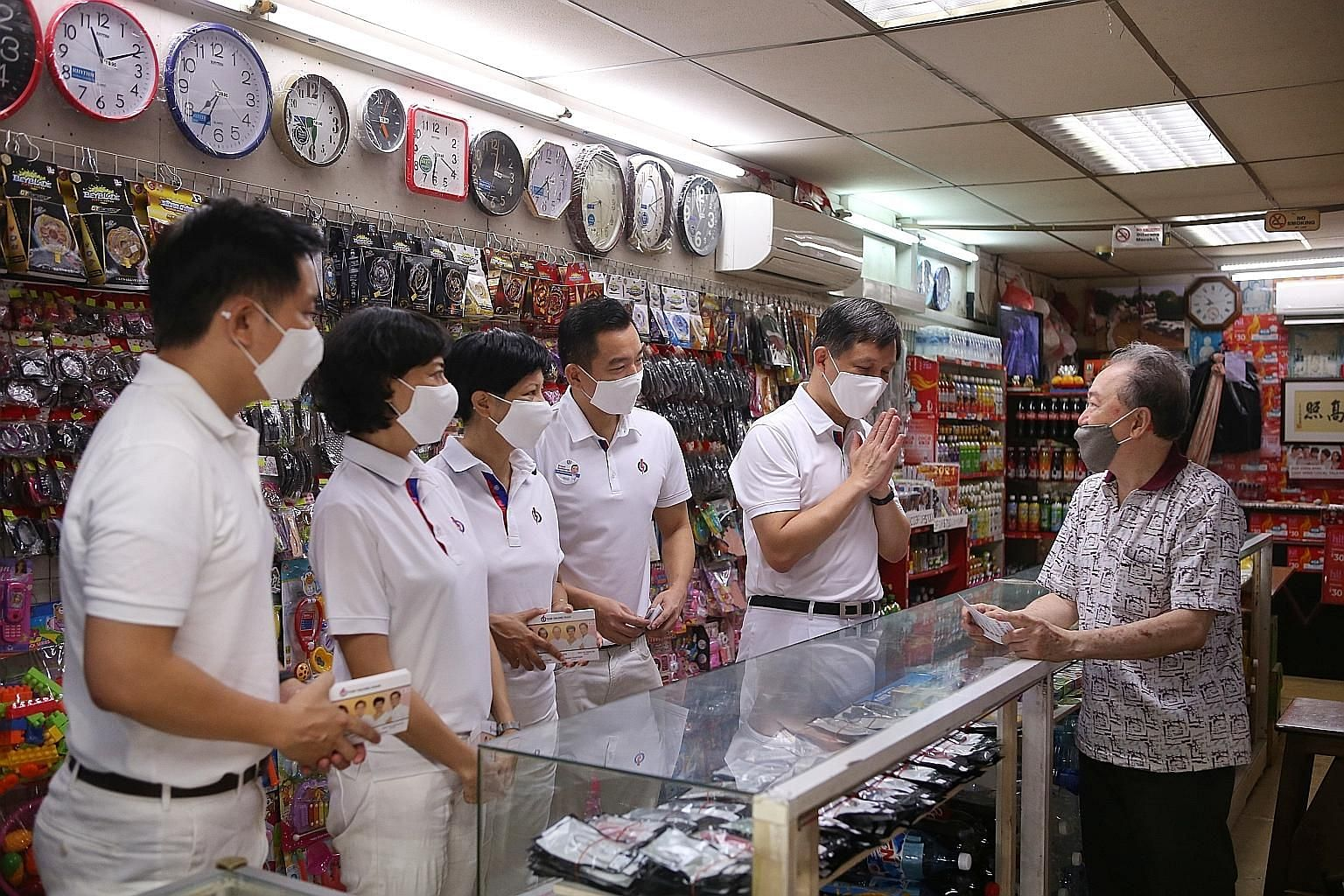 Trade and Industry Minister Chan Chun Sing greeting a shopkeeper on a visit to ABC Brickworks Market and Food Centre yesterday, with fellow members of the PAP team for Tanjong Pagar GRC (pictured from left) Alvin Tan, Joan Pereira, Indranee Rajah and